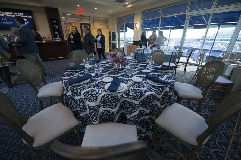 beautiful linens from Select Event Rental and a peek of the Navy Stadium view