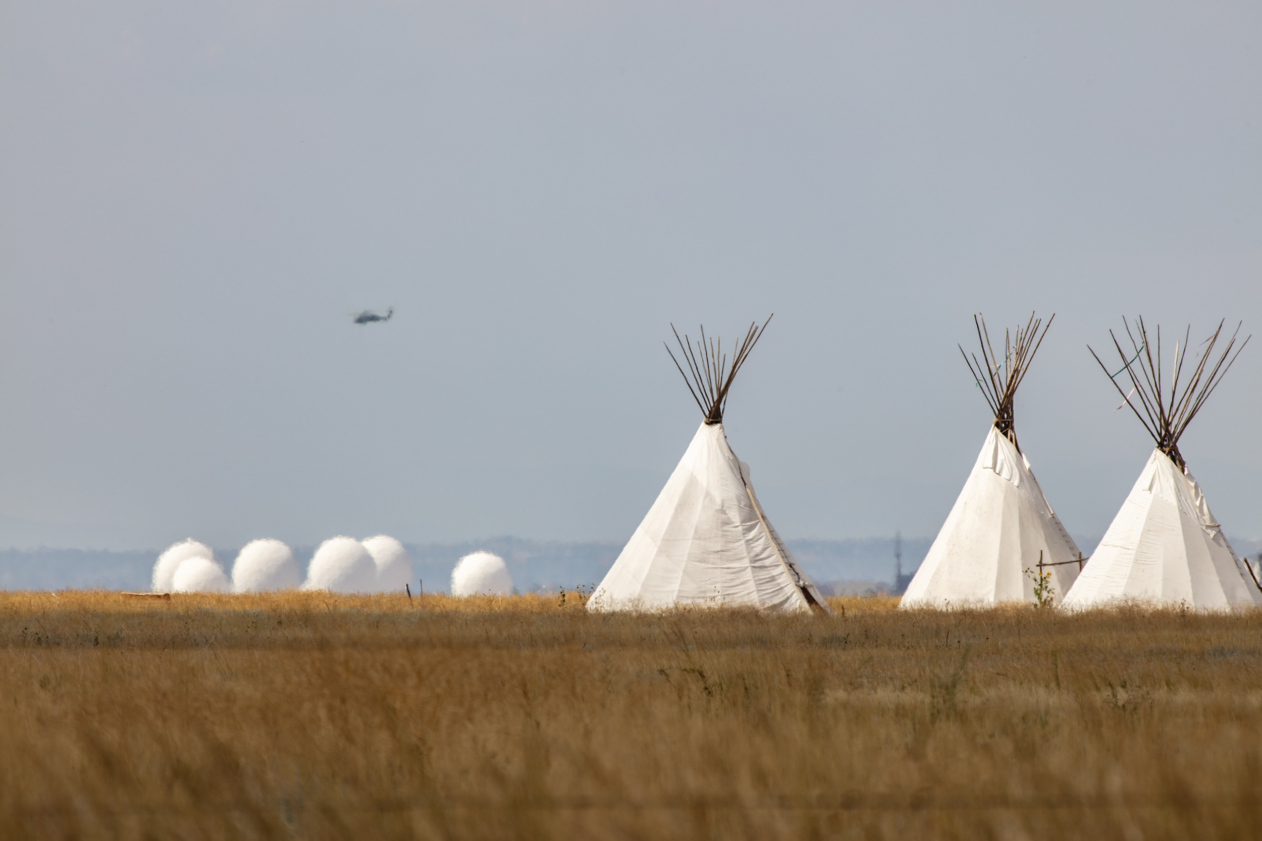Military Radomes used to track missile telemetry and space junk, Tee-Pee's, Blackhawk Helicopter.