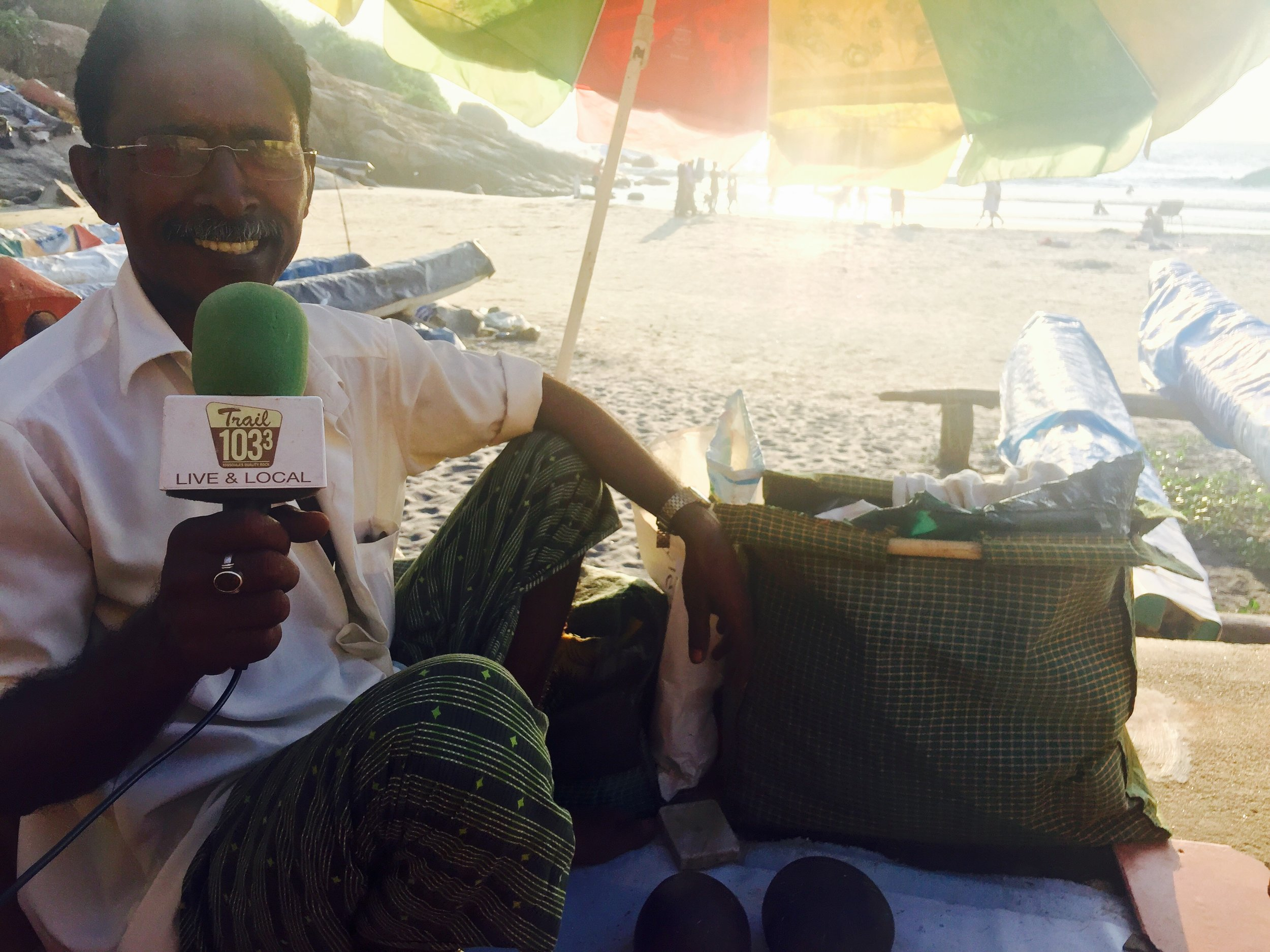 On the edge of the Arabian Sea, Mandela interviews Saleem Ahmed. Saleem is a third generation fisherman who specializes in hand carved coconut artwork.