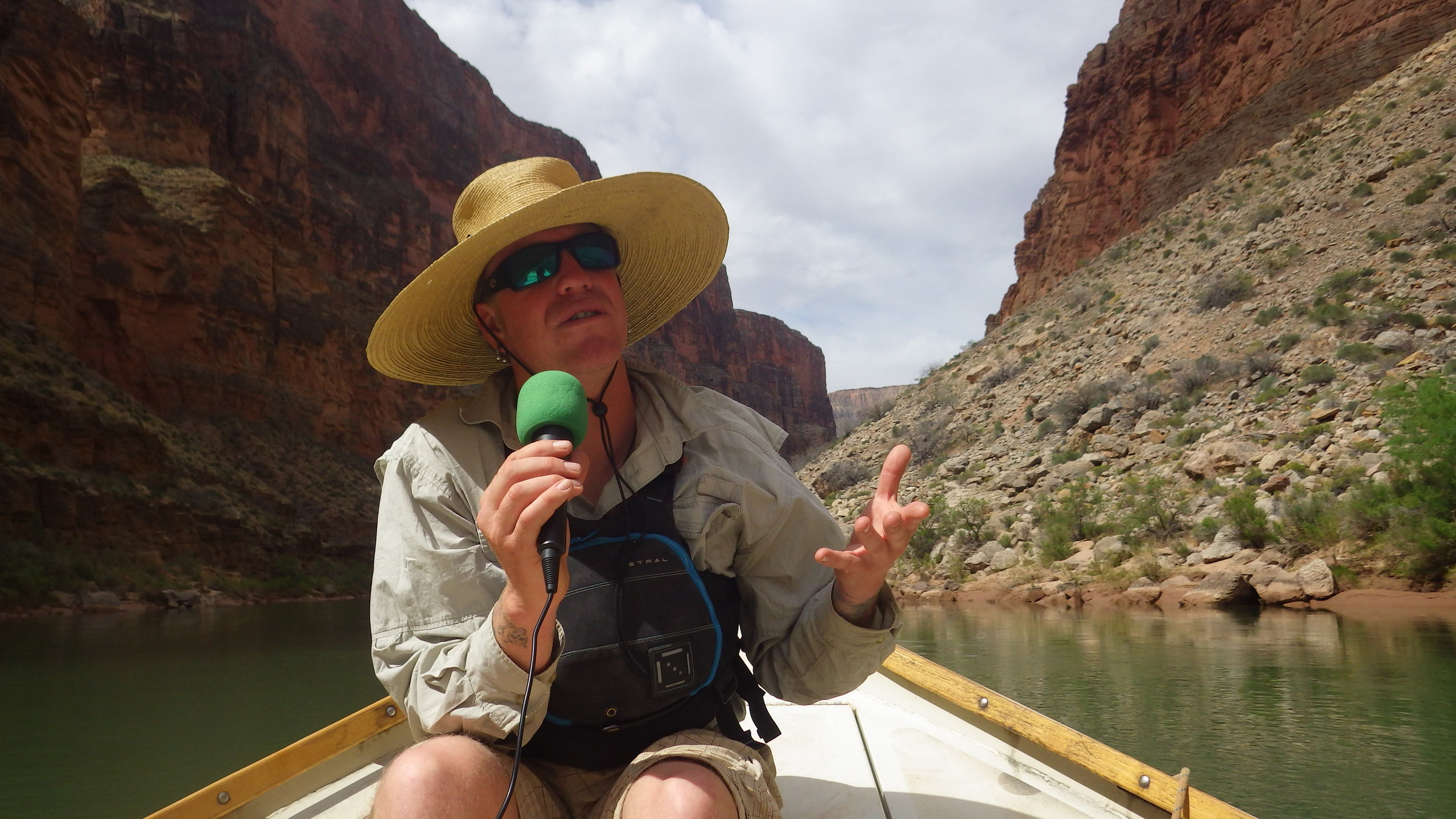 Recorded in a dory floating down the Colorado River in the Grand Canyon! Mandela's interviews Liam O'Neil. Liam grew up in the boathouse of his father's raft company & now works as a talented doryman, raft guide & kayak guide in the Grand Canyon, Lochsa & other rivers around America's northwest.