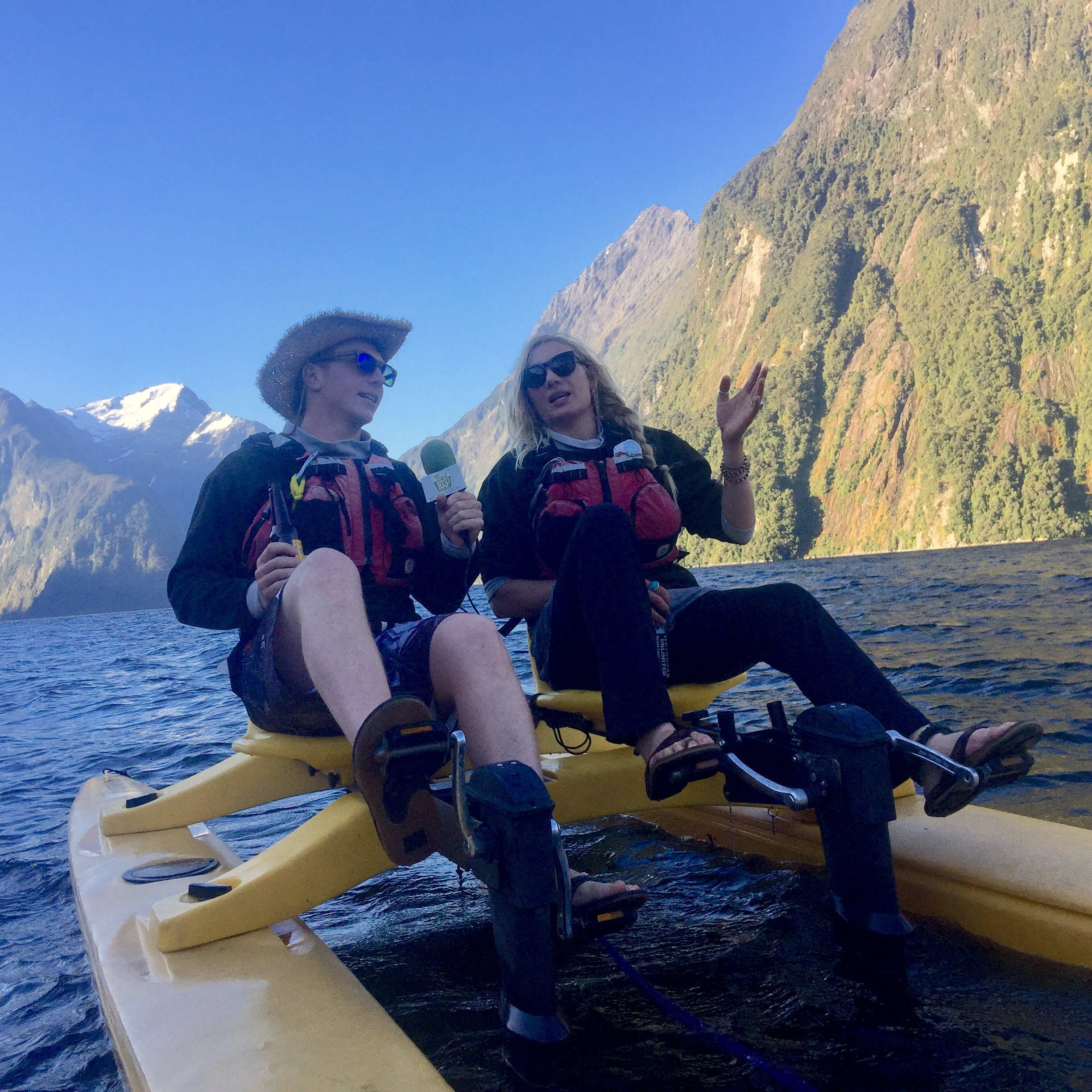 "Mandela interviewing Callum Morrison as they peddle the ""Sea-Cycle"" around The Milford Sound in Fiordland National Park on New Zealand's South Island's West Coast. Callum is a kayaker who guides custom cultural & river tours in Nepal."