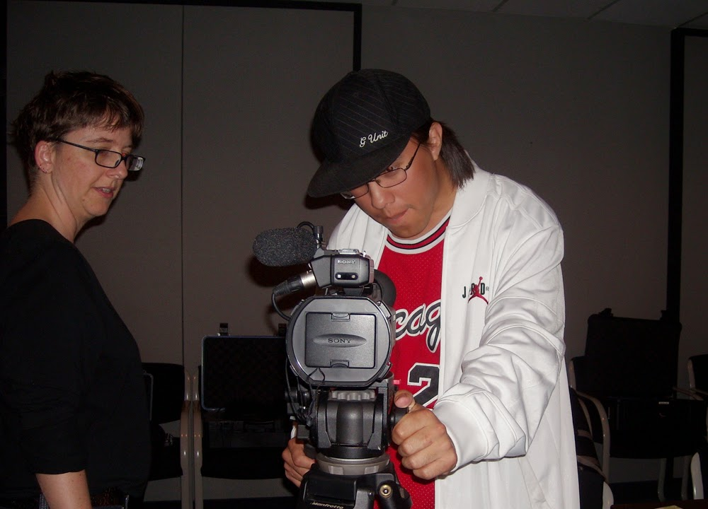 Perry is a confident with the camera as mentor Lisa g looks on