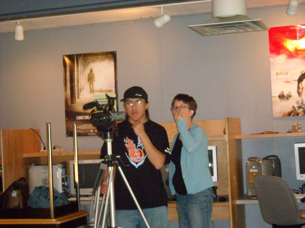 Perry works the camera with mentor Lisa g's help