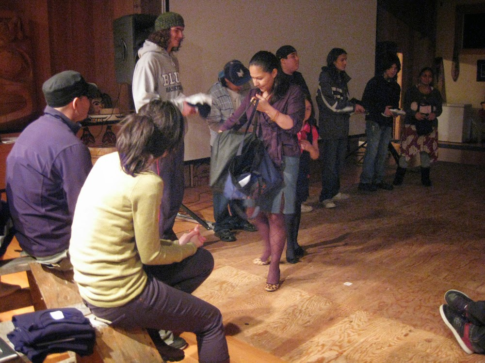 Lucille, xaad kil language scholar hands out presents to the filmmakers!