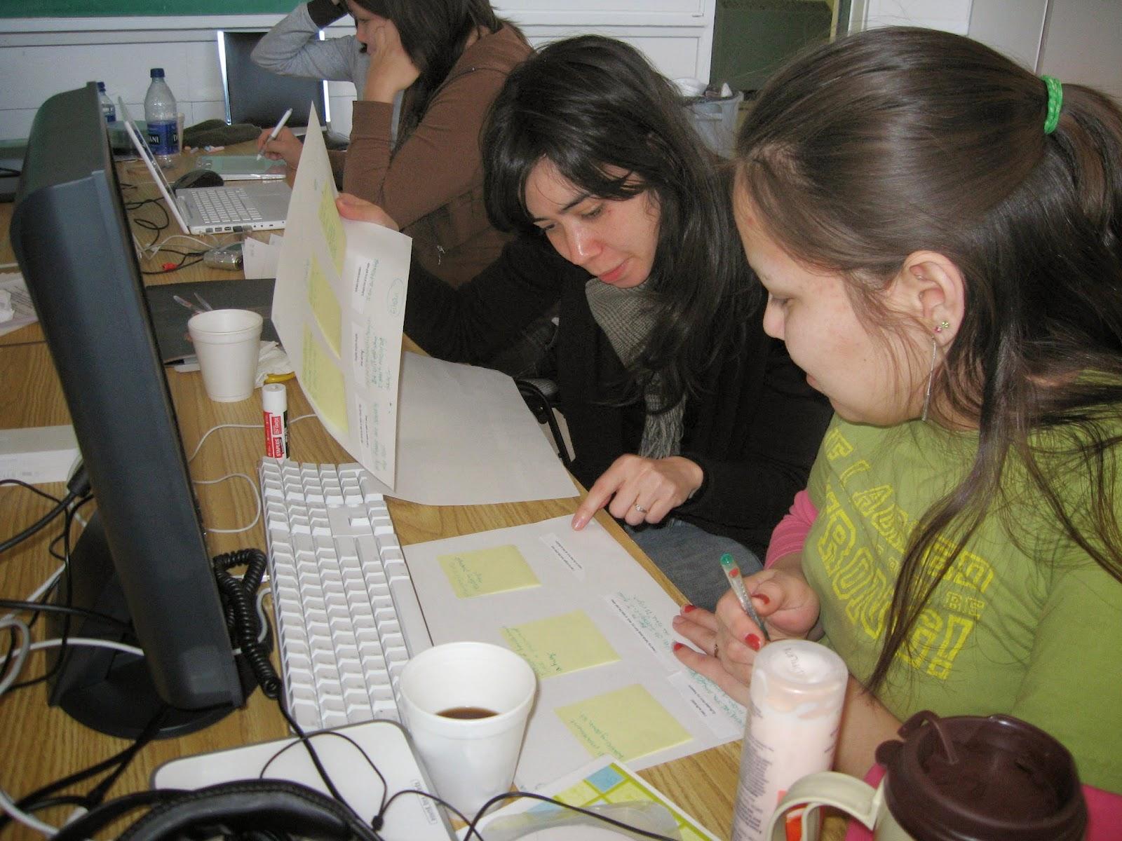 Mentor Catrina and Sherylanne make plans for media gathering