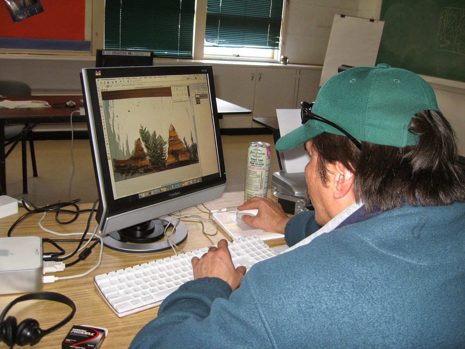 Marvin creating his collage imagery in photoshop