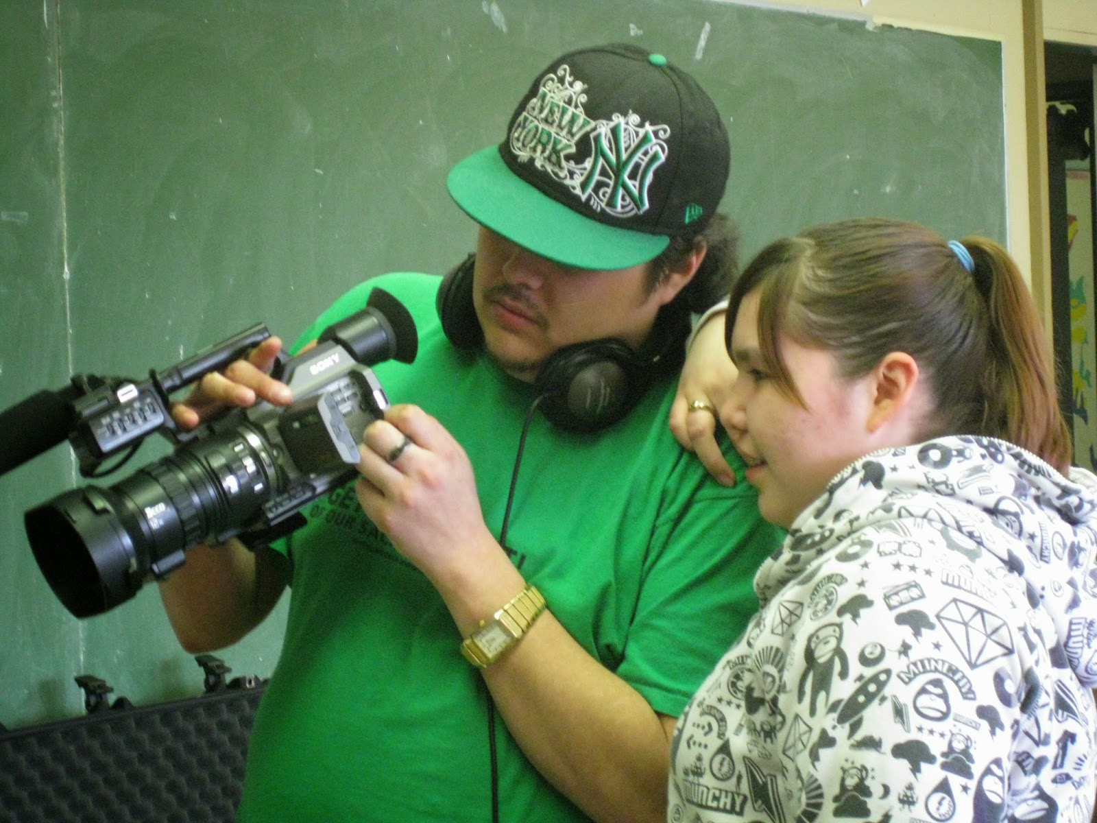 Alex and Nishan working together learning camera