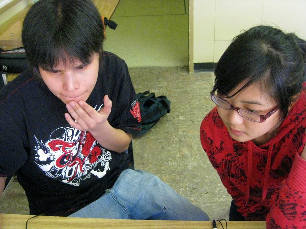 Elisa helps Jaye on his editing