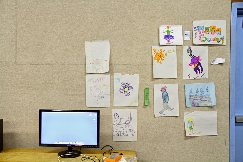 "Our ""Inspiration Wall"" - drawings made when we needed an analog moment"