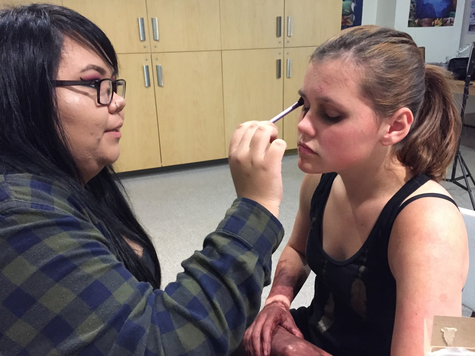 Niccola applies the ghost makeup to Hannah
