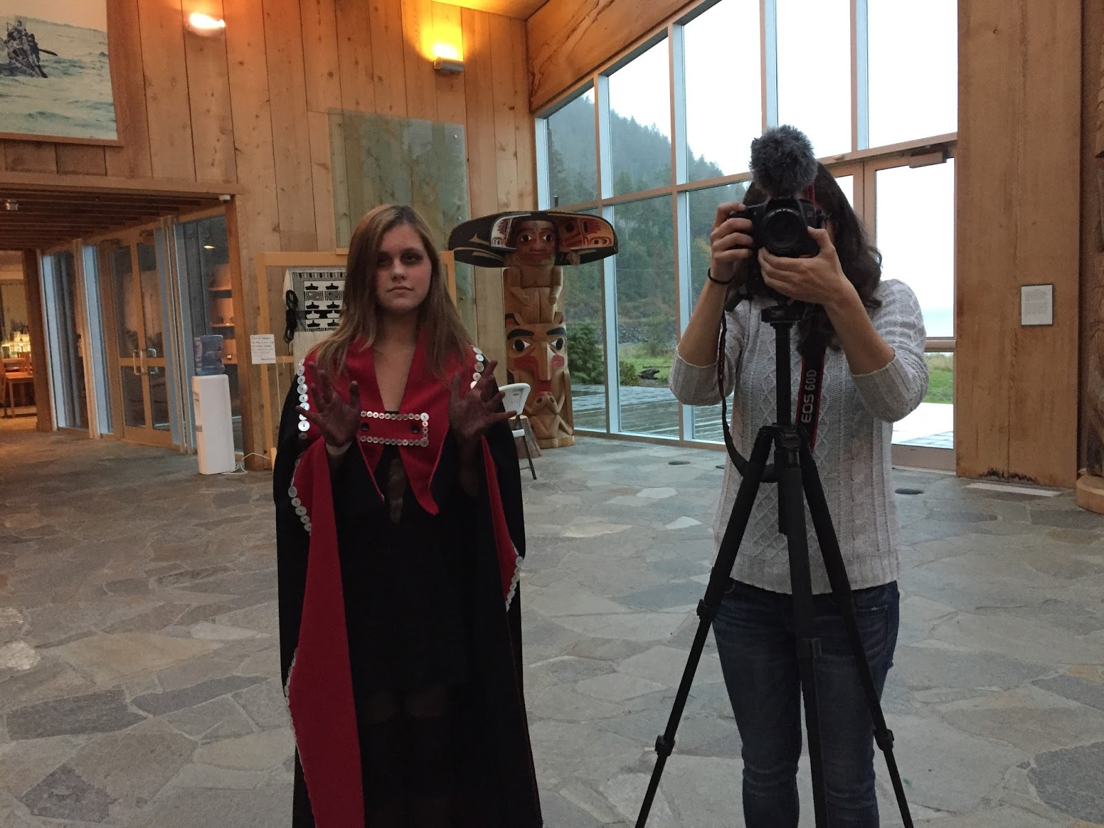 Hannah as ghost and Maria Cecilia as behind the scenes documentarian