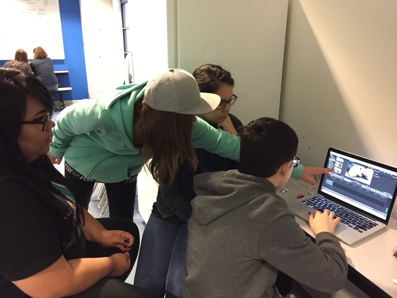 Everyone on Team COFFEE gives input on shots and edits. Mackenzie currently takes control of the computer