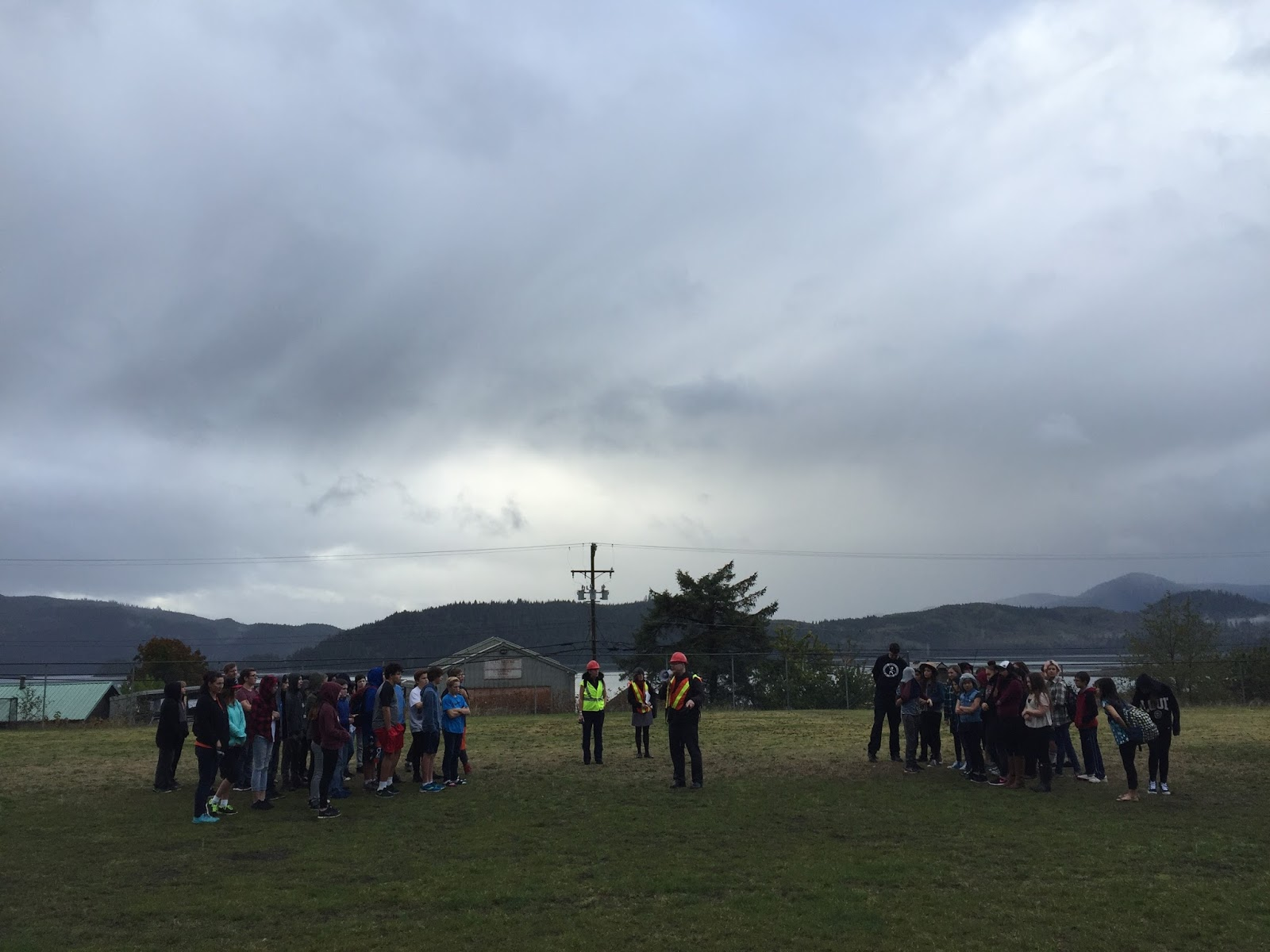 The principal, Devlin, announces that we all have to walk to the top of the hill