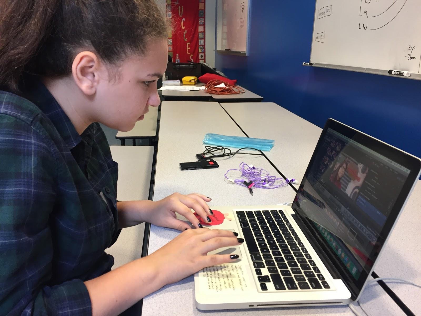 Jacey is quick to learn the editing program and adds titles and voices to the rough assembly of their documentary