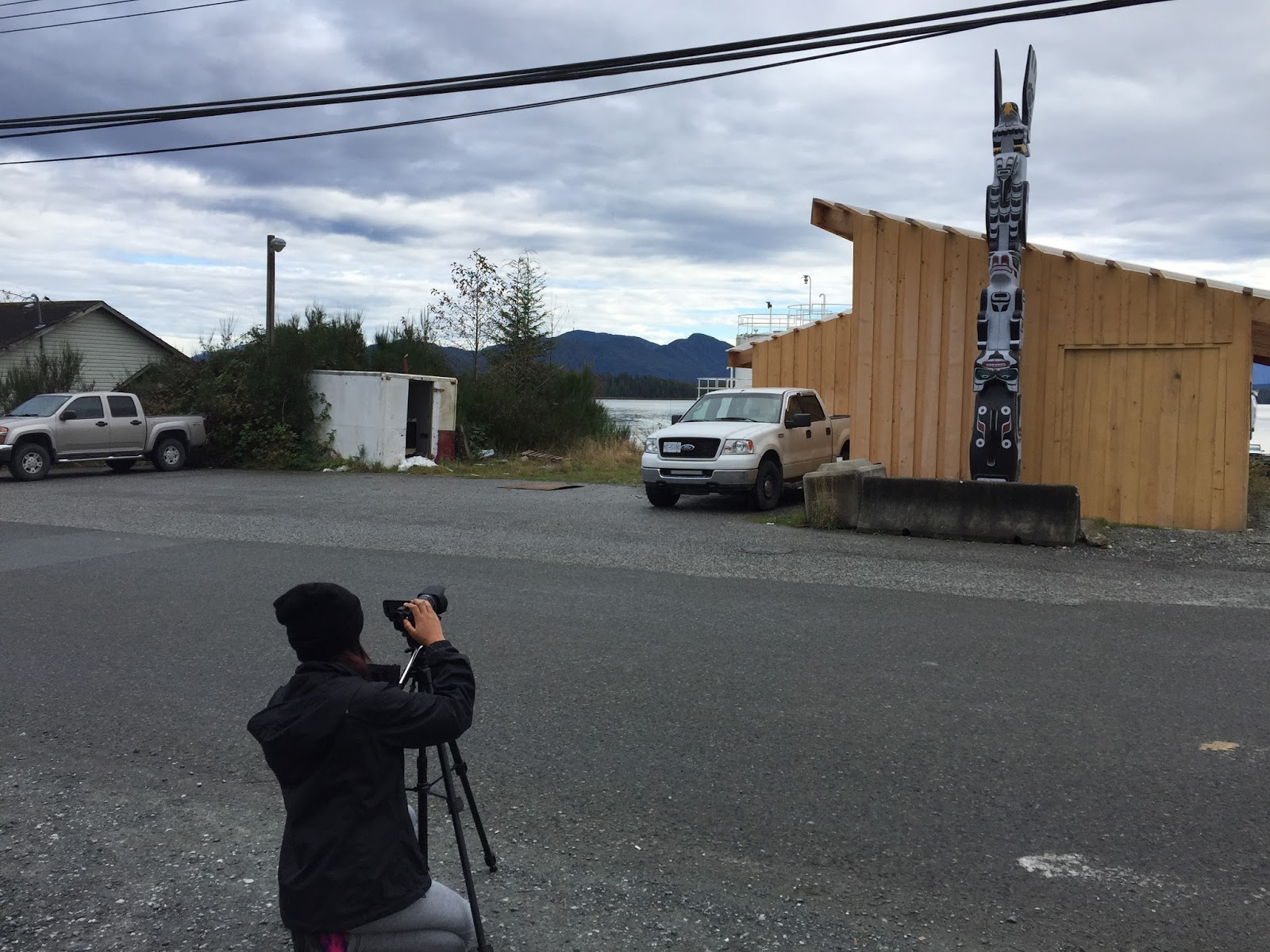 Nadia practices camera moves to capture another totem pole by the store