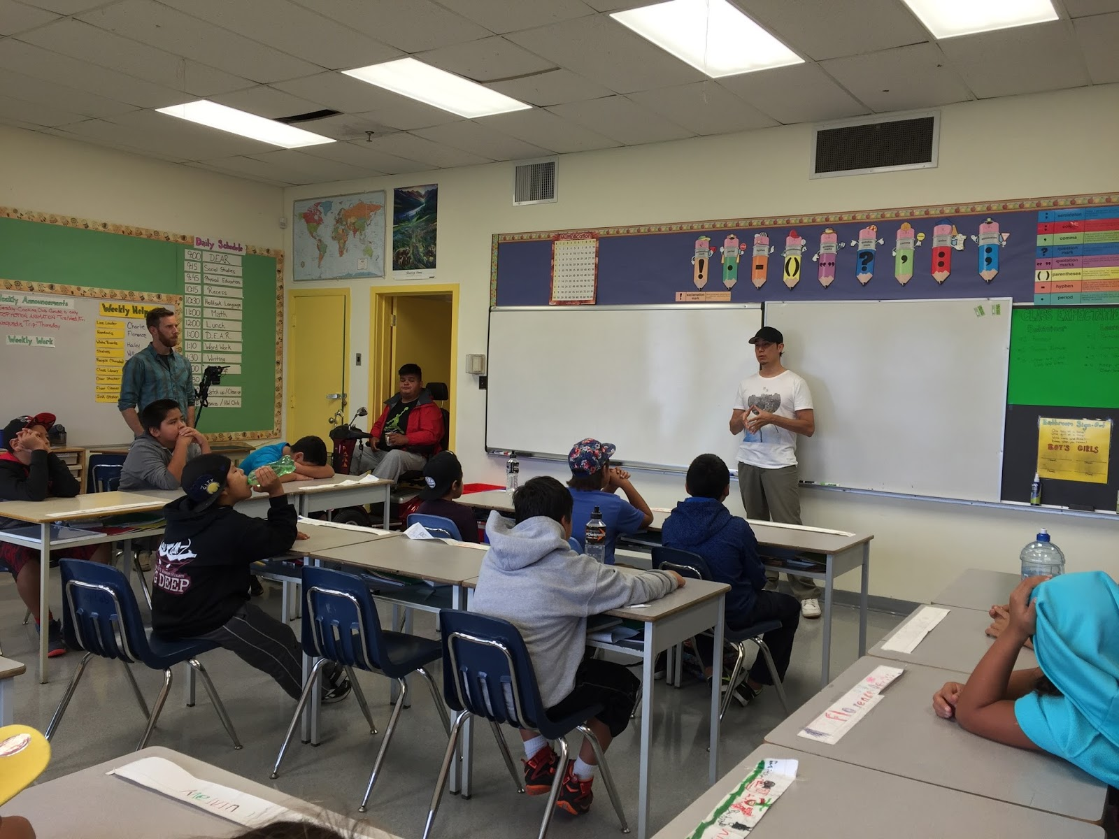 New animation mentor, Stephen Gladue, introduces himself to the class. Teacher Patrick and TA Mel look on.