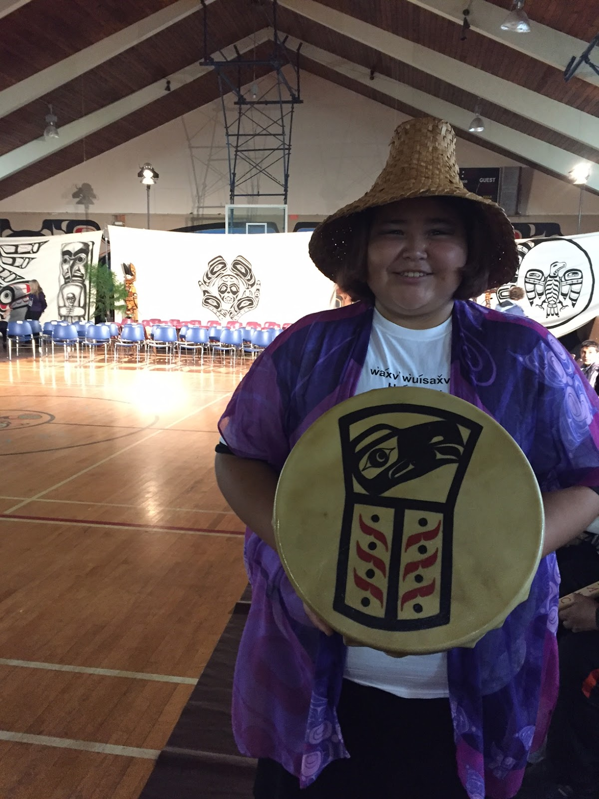 Our World filmmaker alumni, Natalia, holds a drum made by her Grandmother for this occasion!