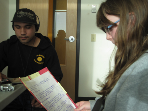 Brandon helps Sarah record her voice-over for her piece about recycling