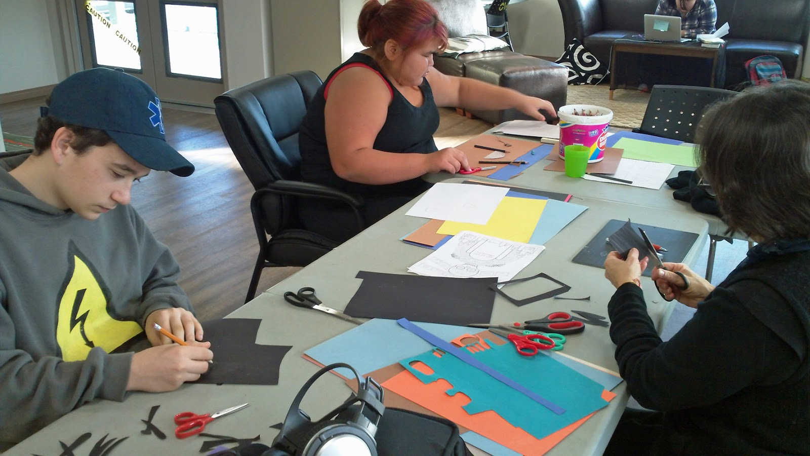 Sawyer and mentor Tracy create a spider while Natalia work on backgrounds