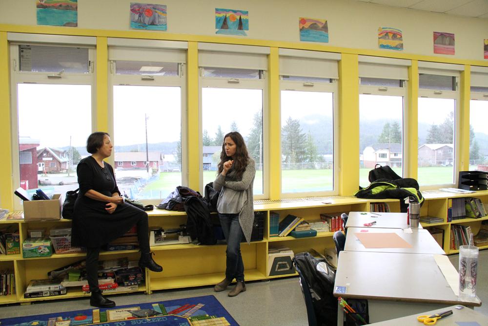 Tracy and TA, Valentina, talks during recess
