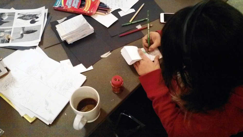 Jessica is focussed finishing her final flip book