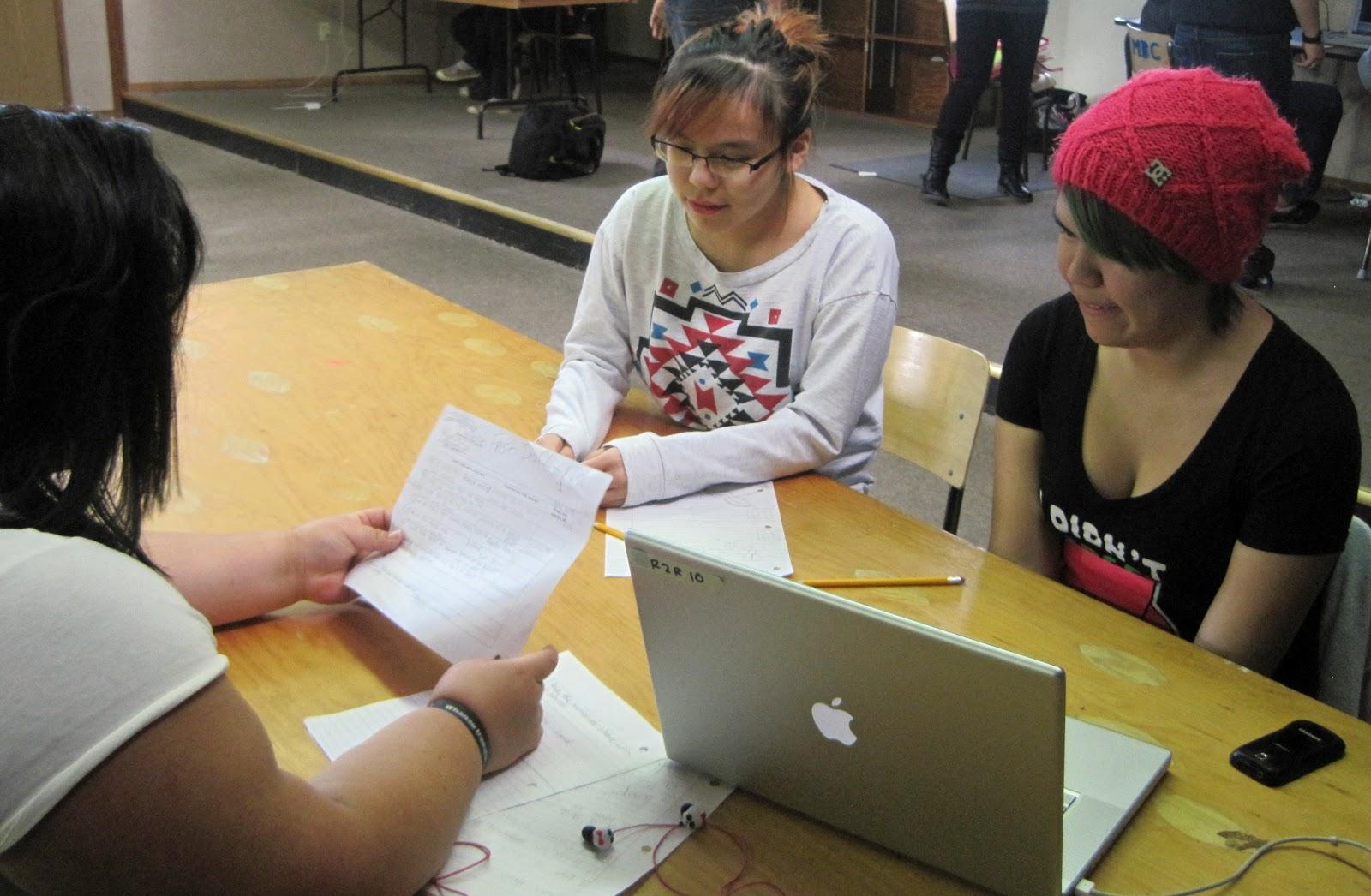Kendra, Danielle and Jordyn work on their story.