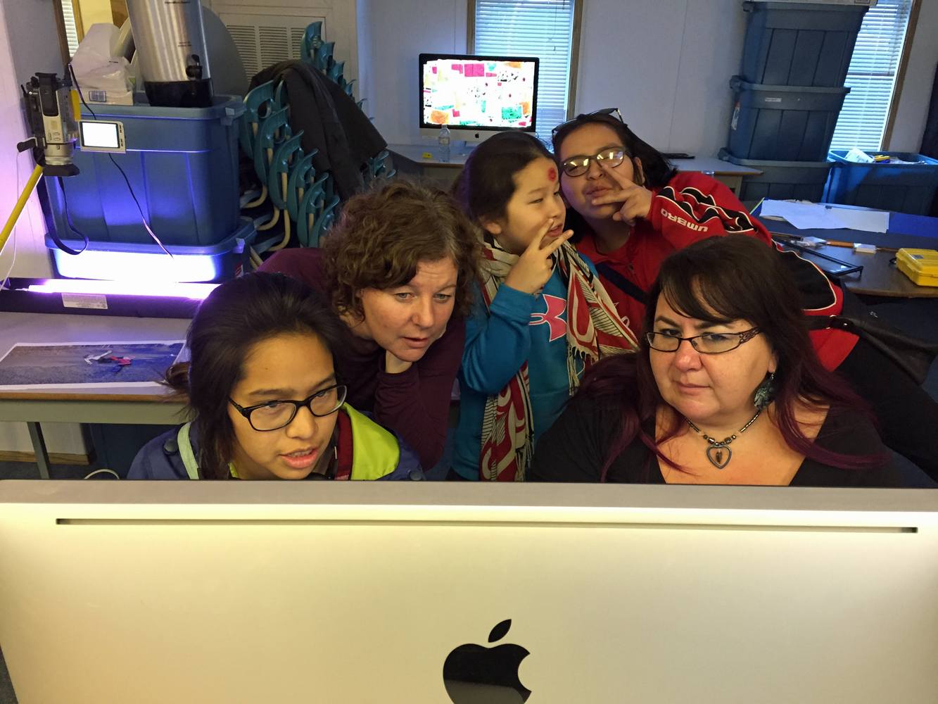 Principal Jillian and Teacher Leah check out Thelma's latest edit (While Emma and Kelly ham it up)
