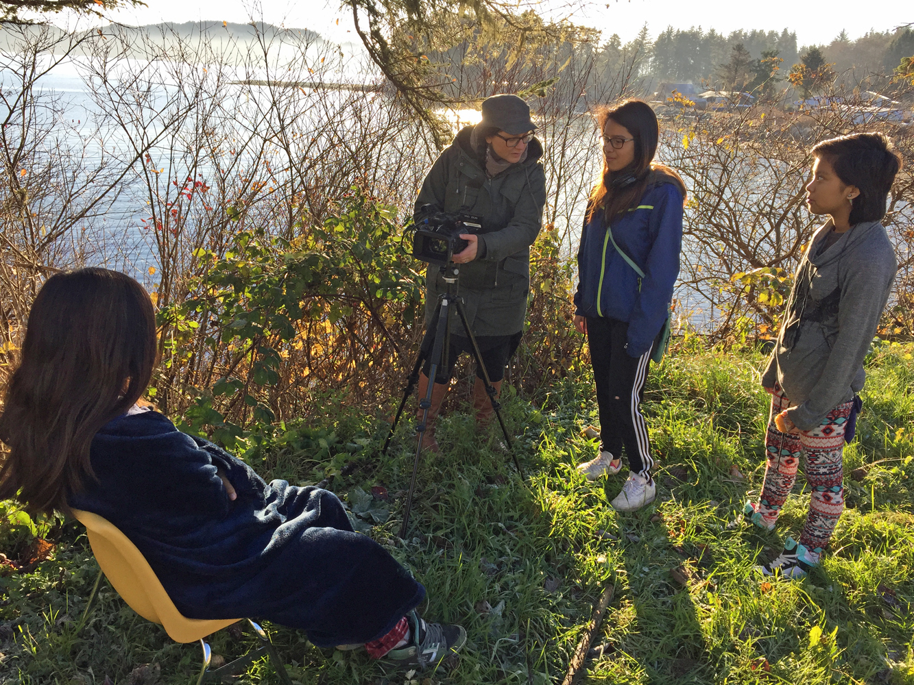 Mentor, Odessa, gives camera tips to Thelma as she interviews her sister Kali and her cousin Shandy.