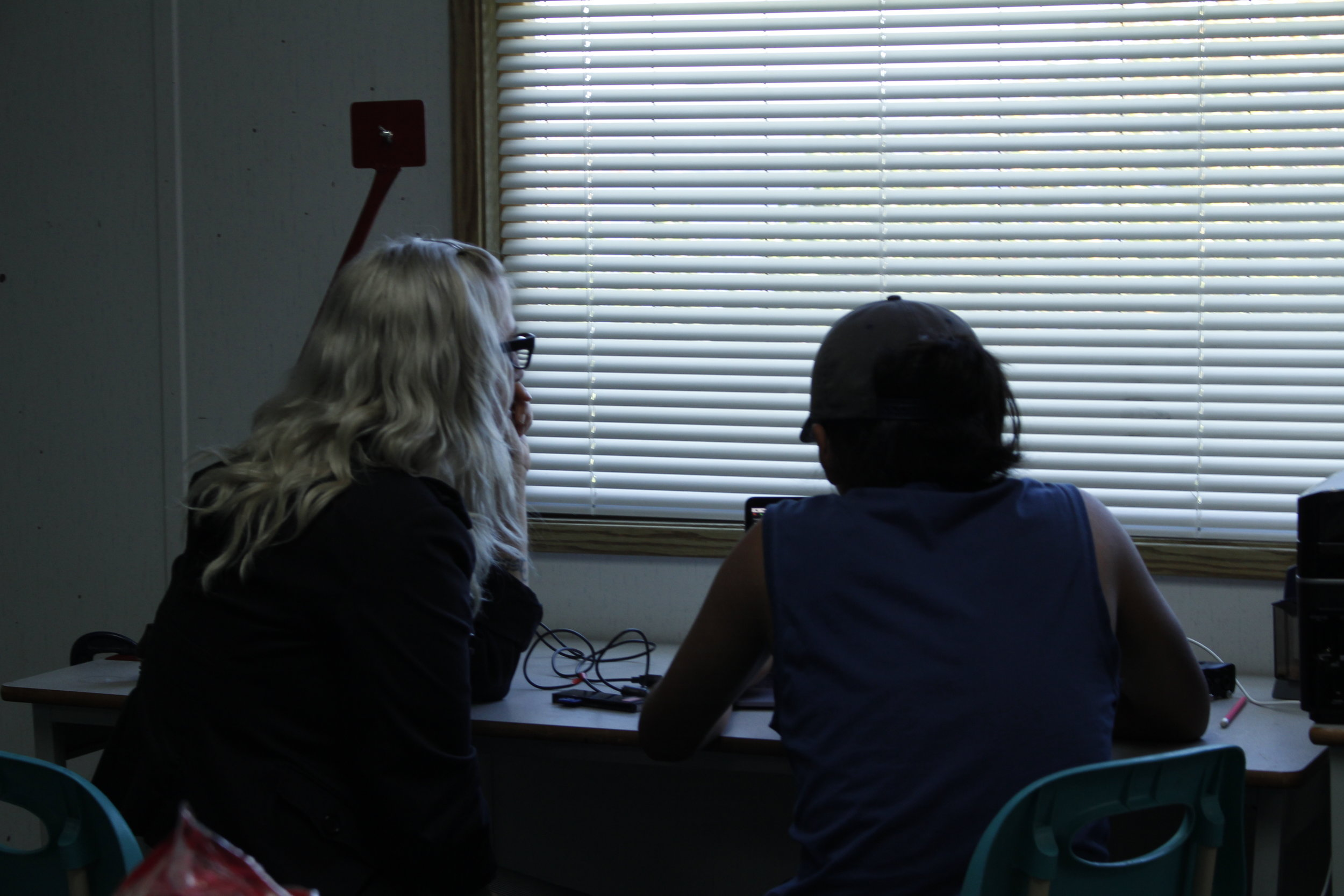 Mentor Lisa g introduces audio editing within Final Cut X to Isaiah.Photo by Roberta Williams