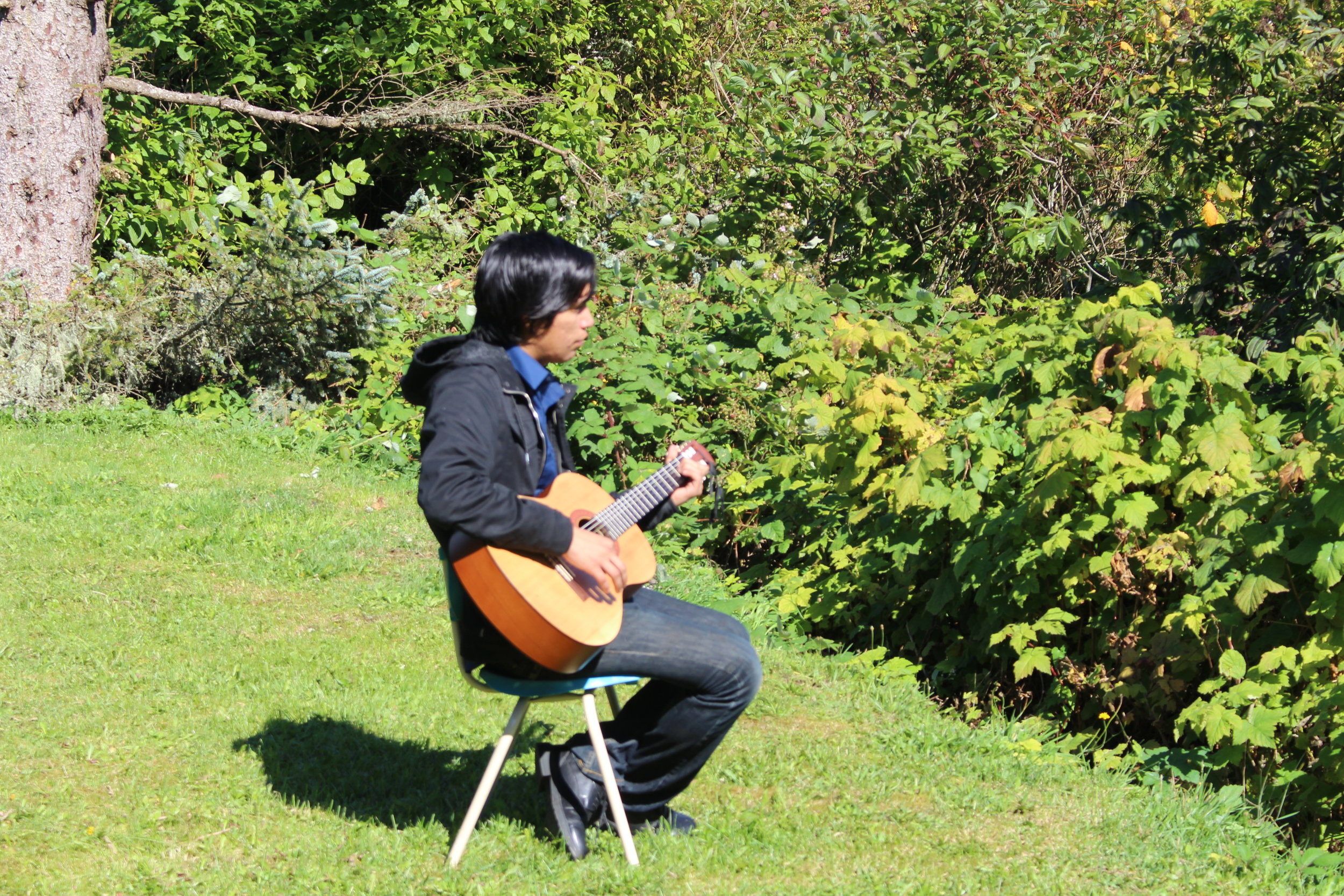 Stephen finds inspiration in music. He plays the guitar and ukulele to work through creative challenges. Photo by Roberta Williams.