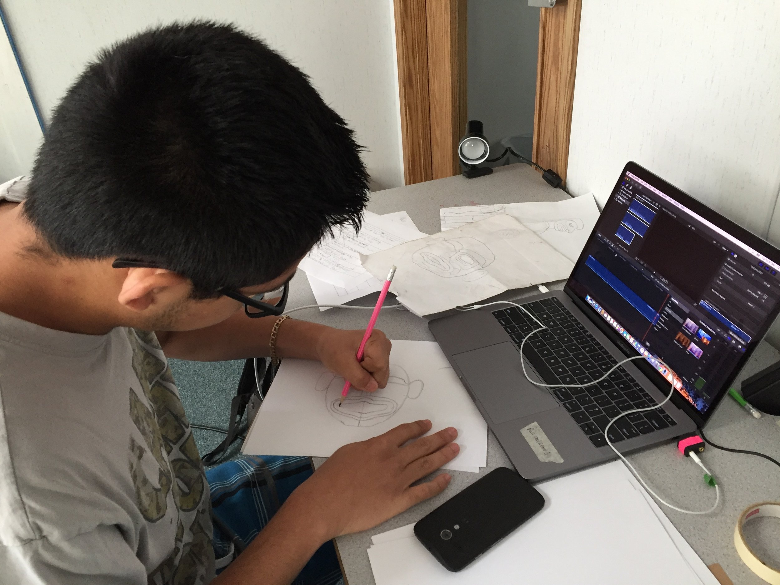 Alex creates his characters for his film.