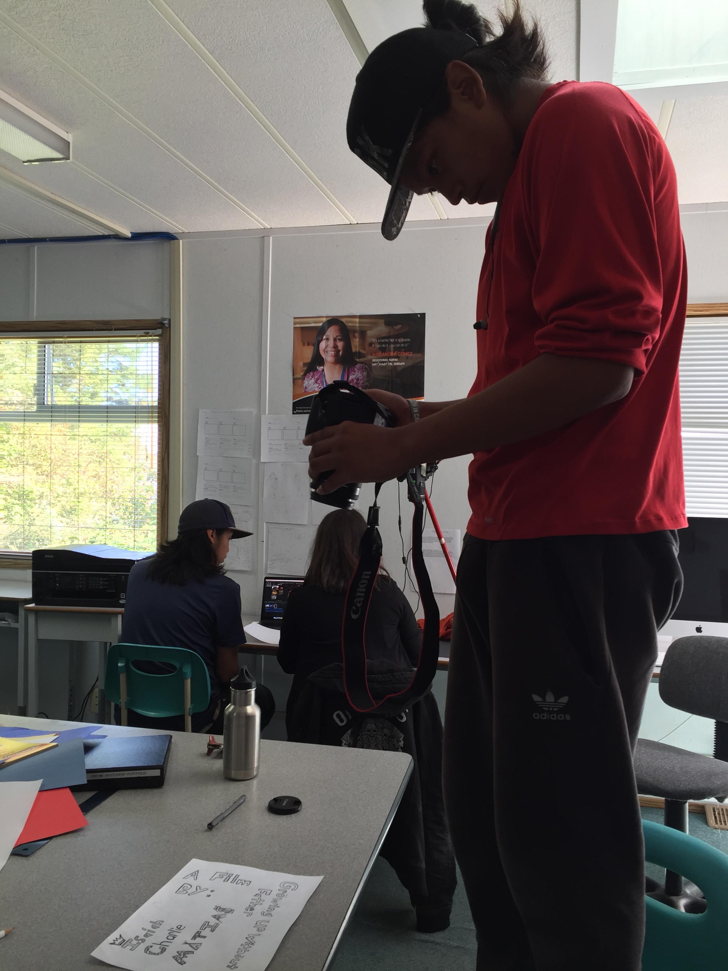 Isaiah photographs his credit artwork.