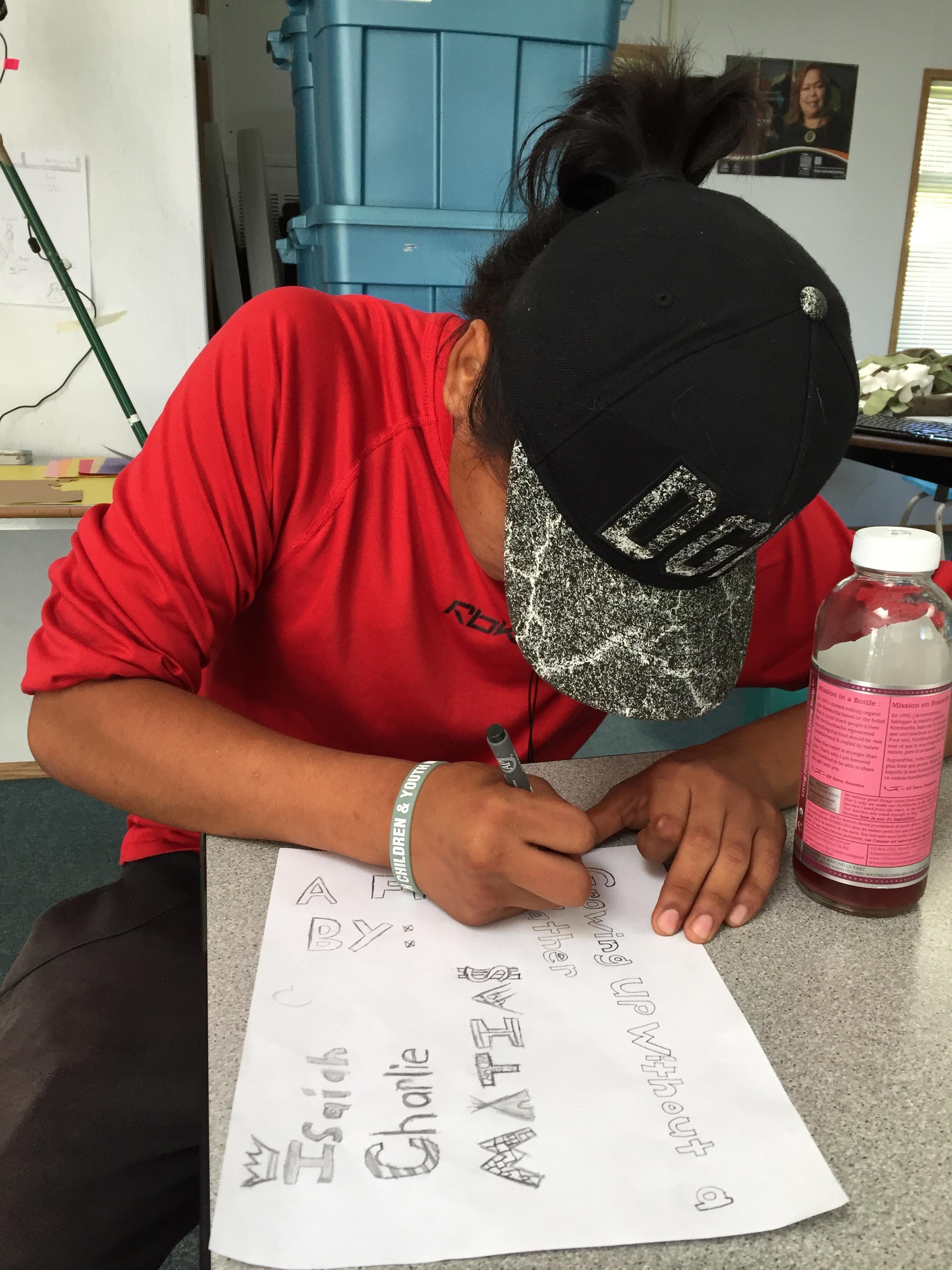 Isaiah creates the artwork for his credits.