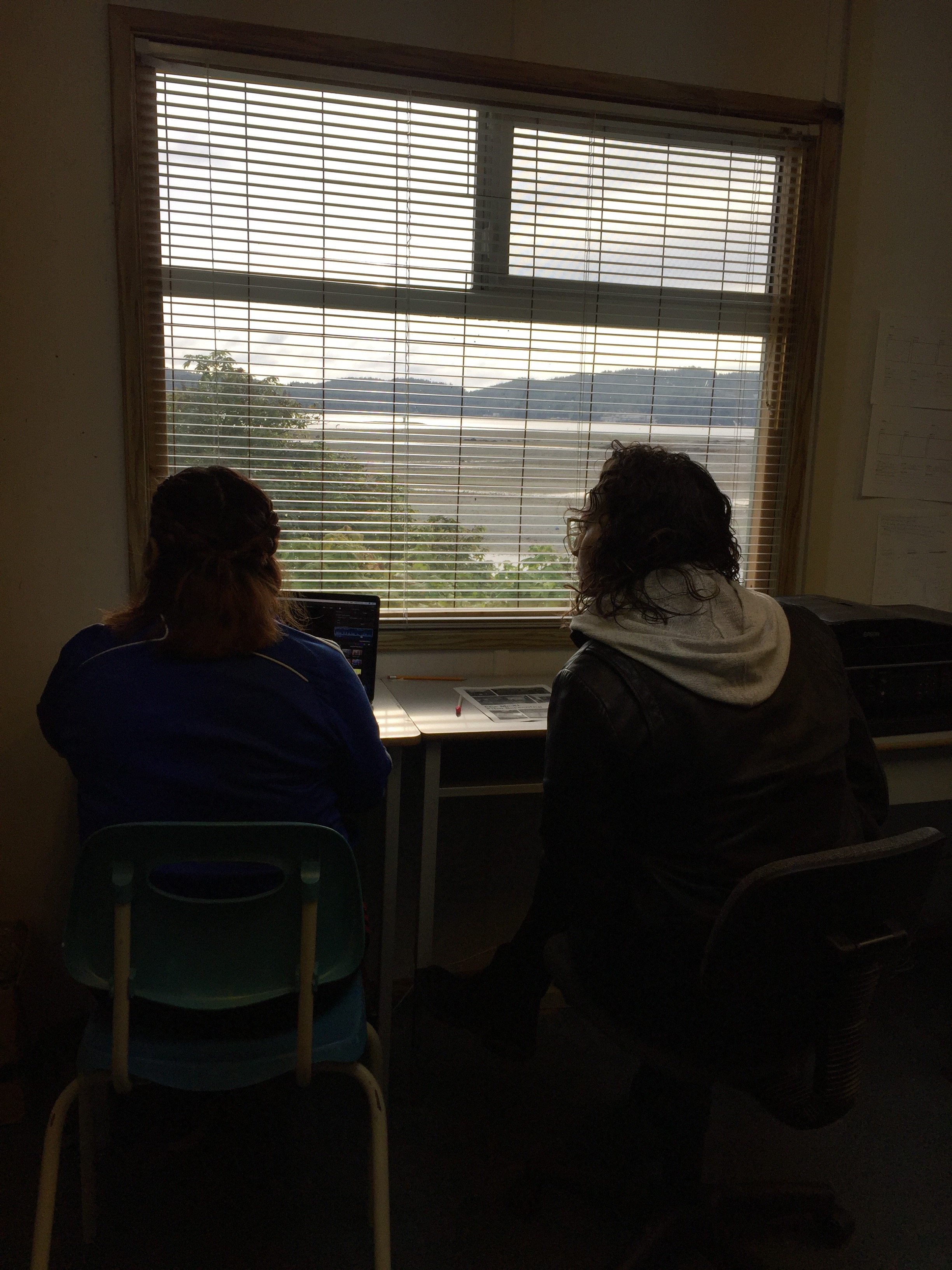 Odessa and Kelly working on an edit with the beautiful morning view!