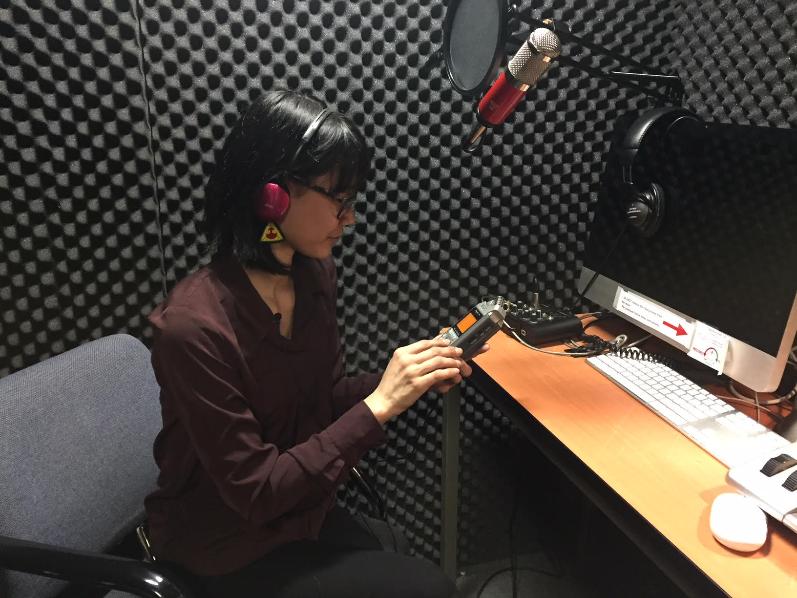Pasha records her voice in the Dawson recording booth