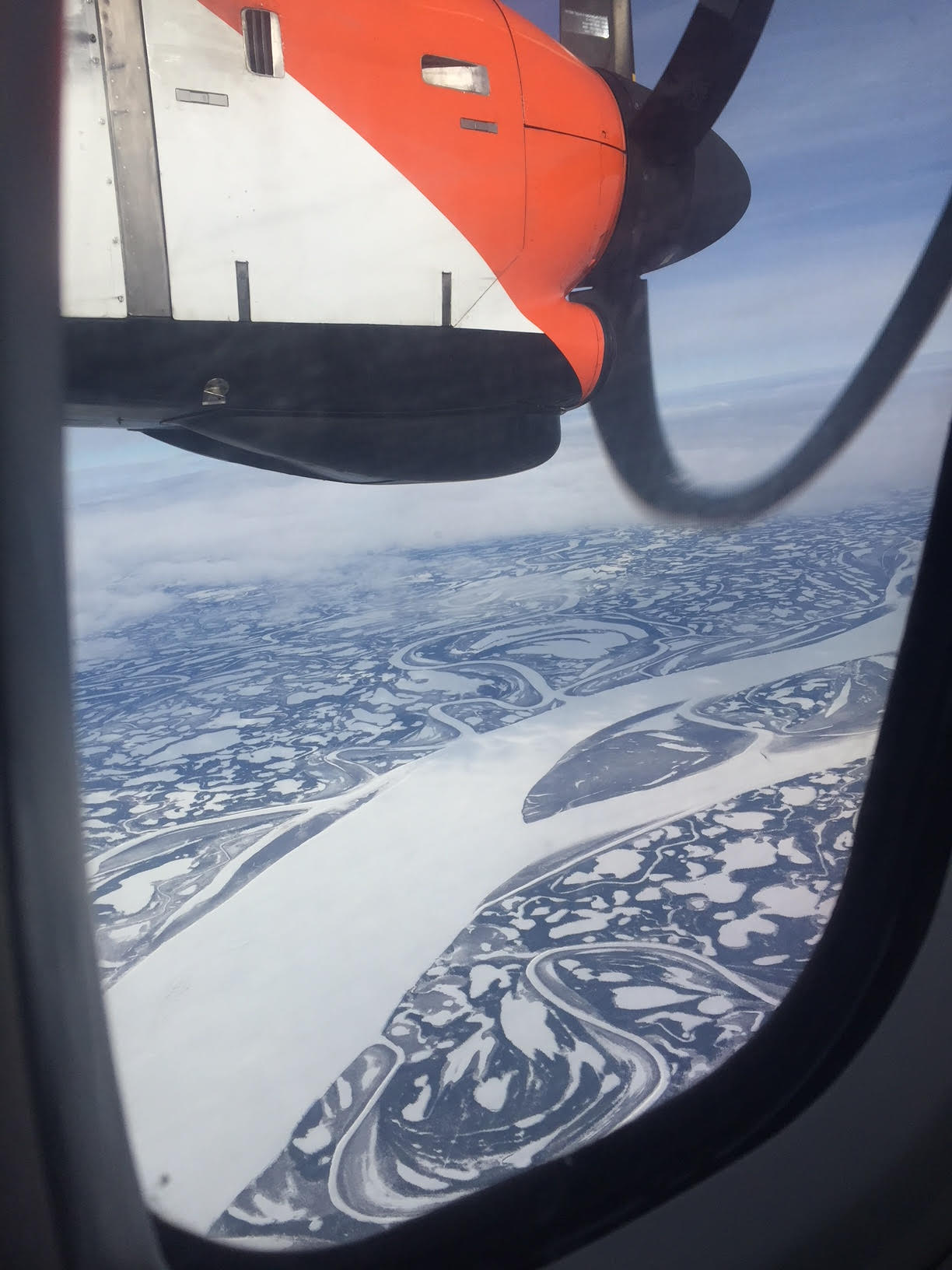 Heading toward Inuvik the frozen rivers and lakes create magical patterns