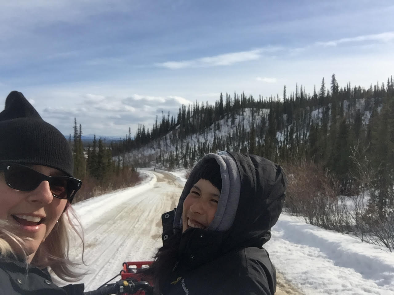 Kayleen and Lisa on the 4x4. (Desmond was filming their drive down the road.)