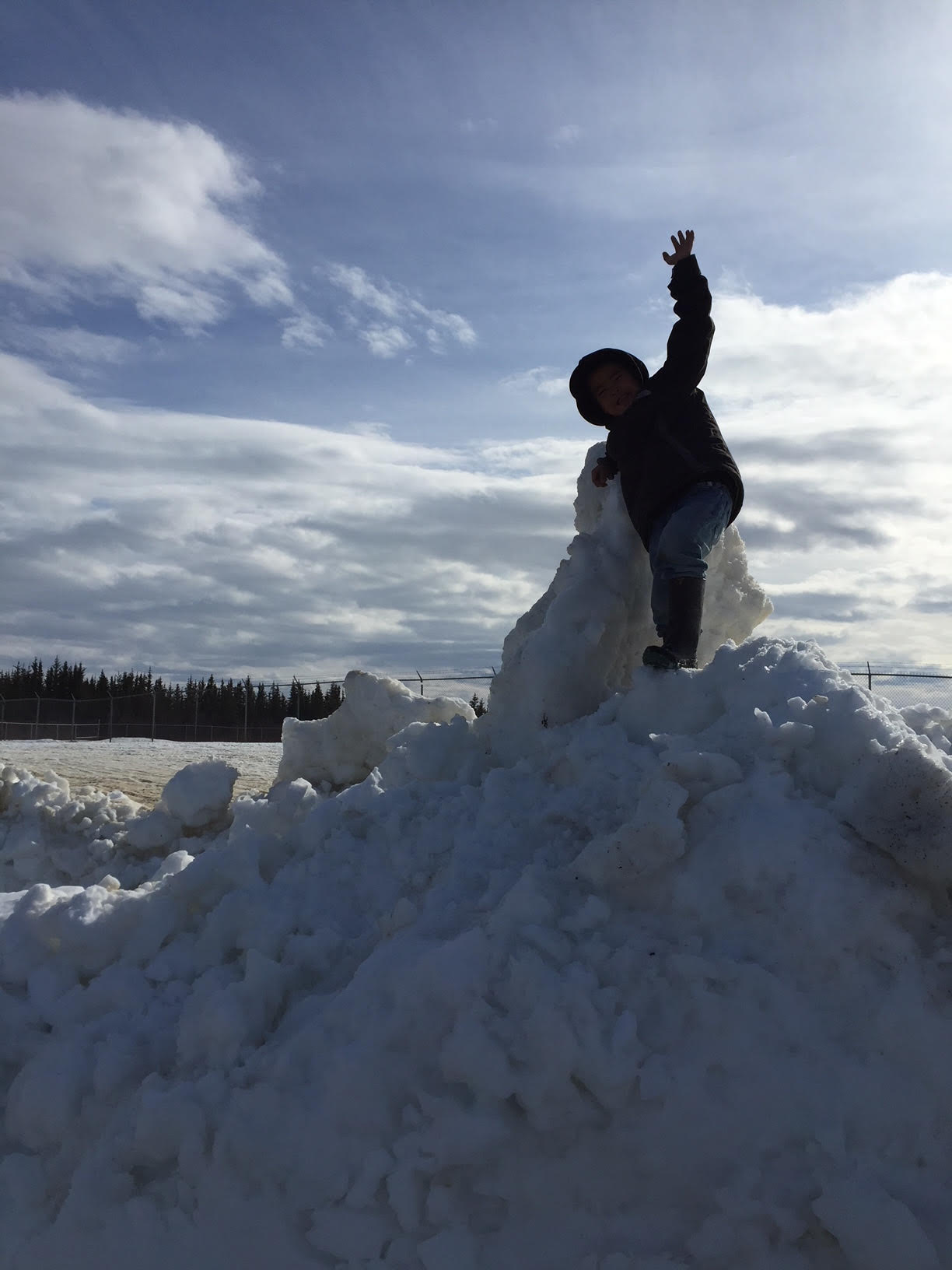 JR climbing on top of the snow for the directors