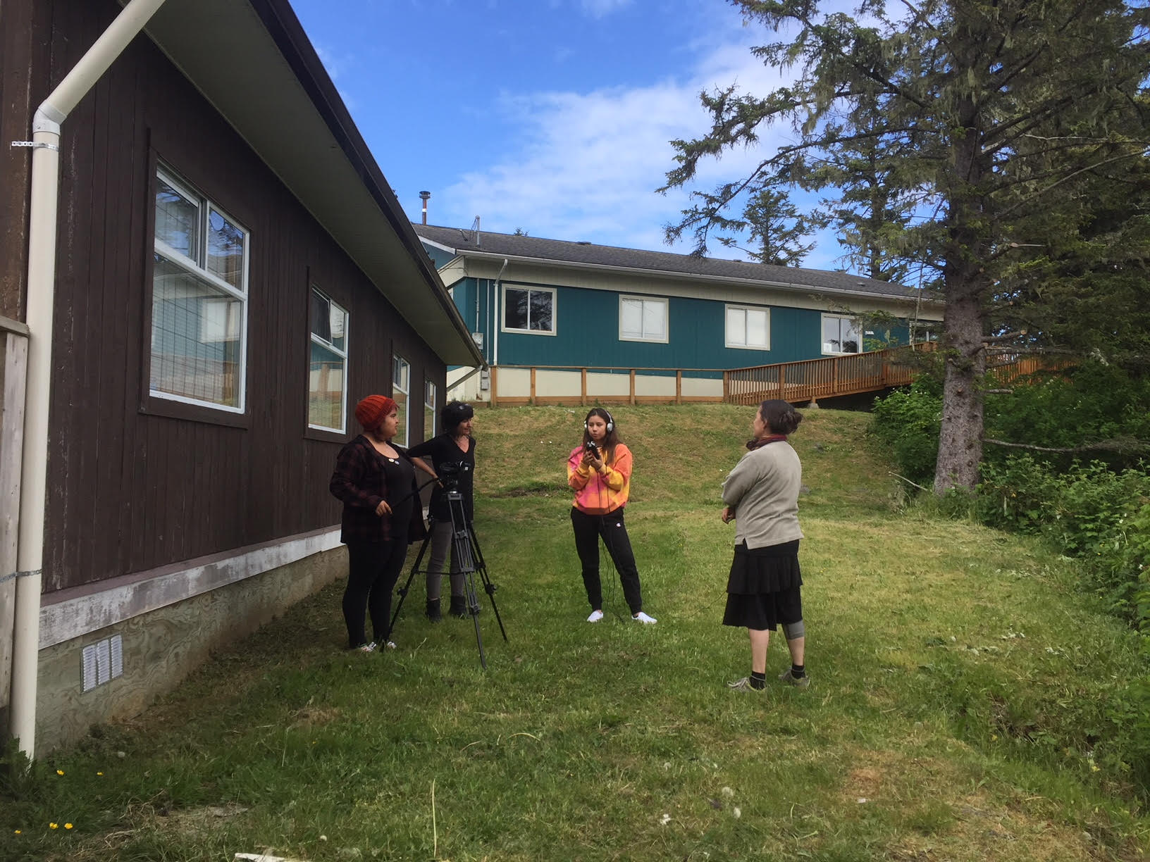 Jade and Winifred practice interview skills outside with Sebnem and Tracy