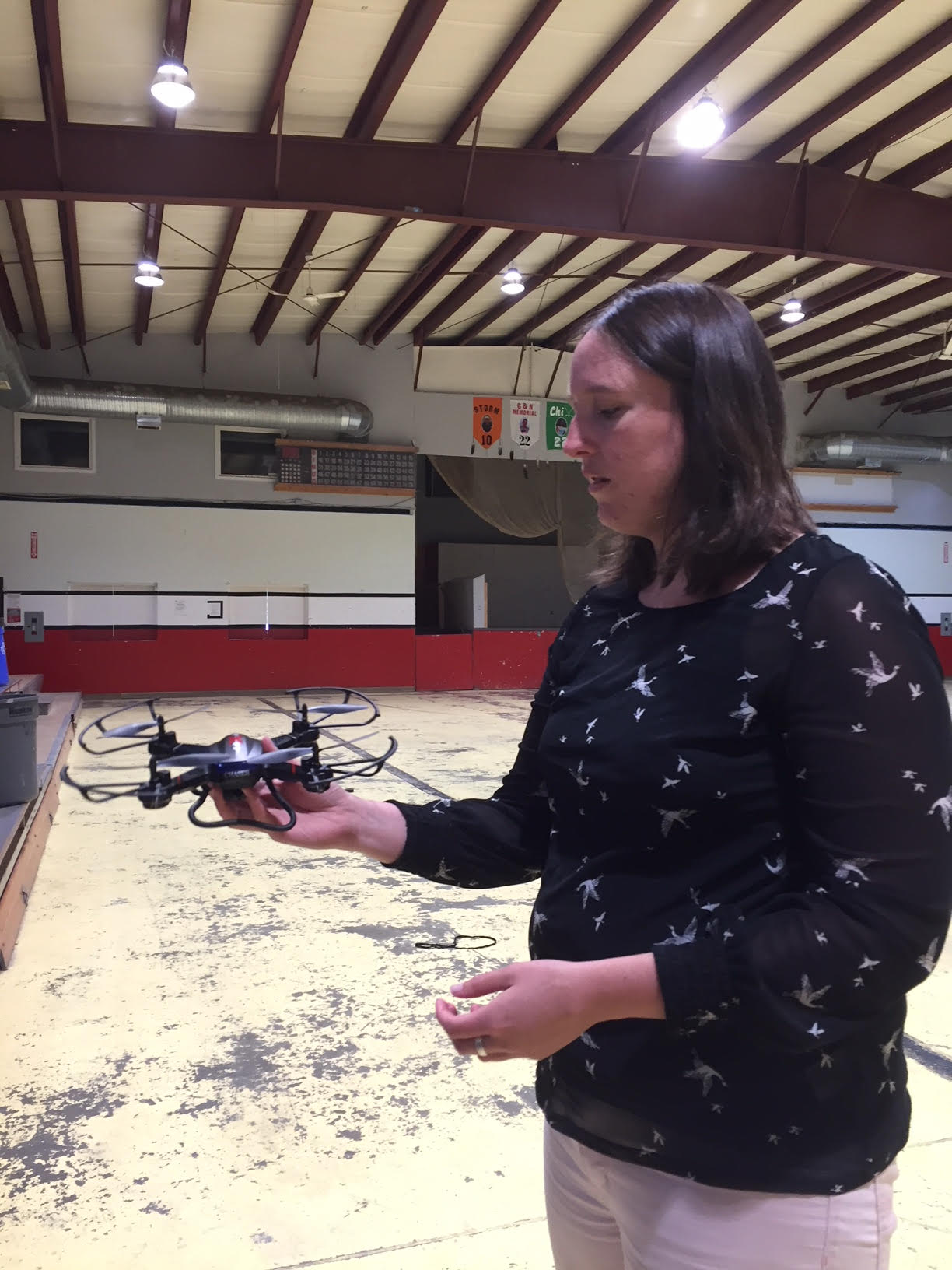 Erin teaches how to turn on and steer the drone
