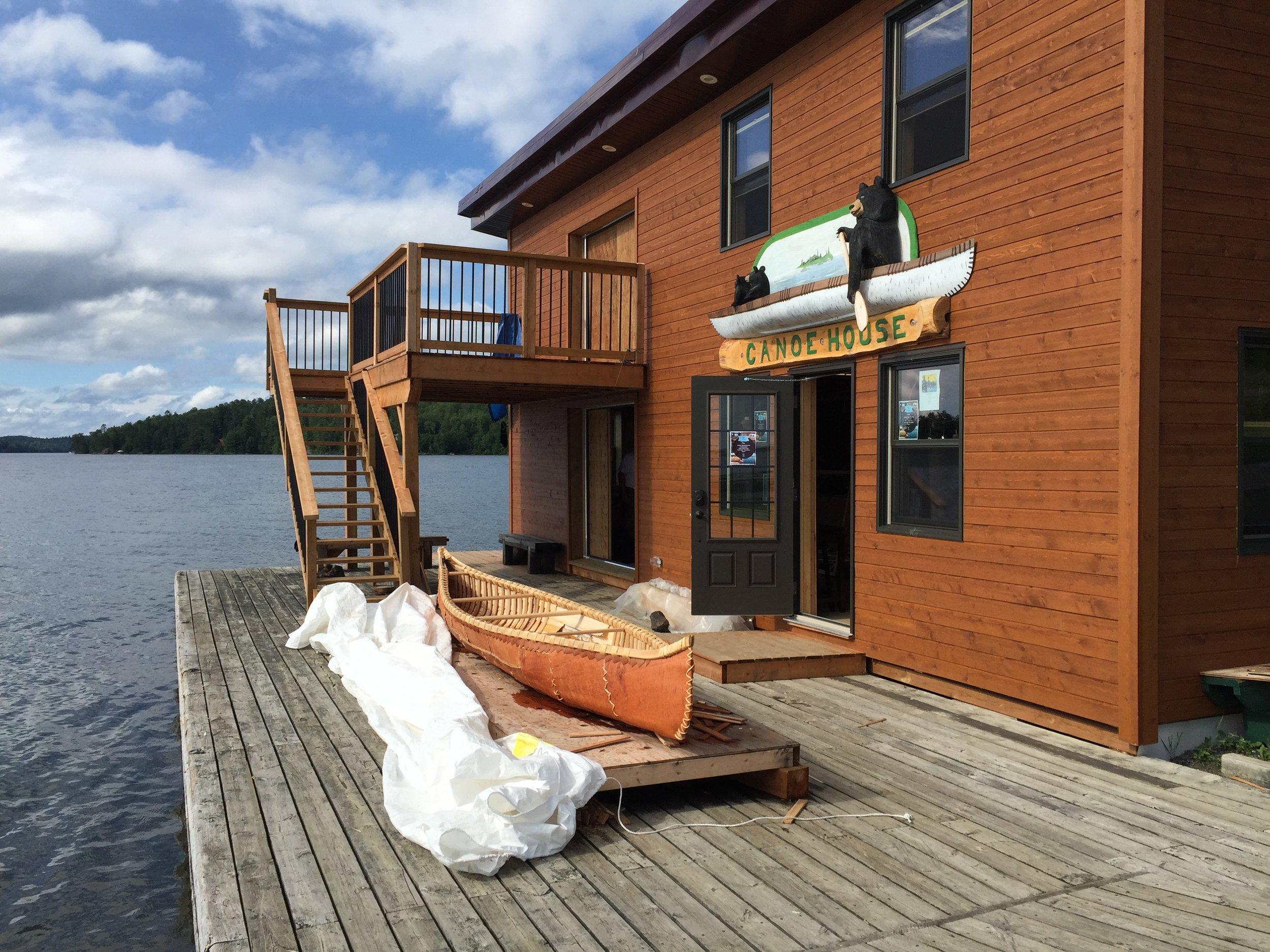 The canoe house with a birch bark canoe in progress