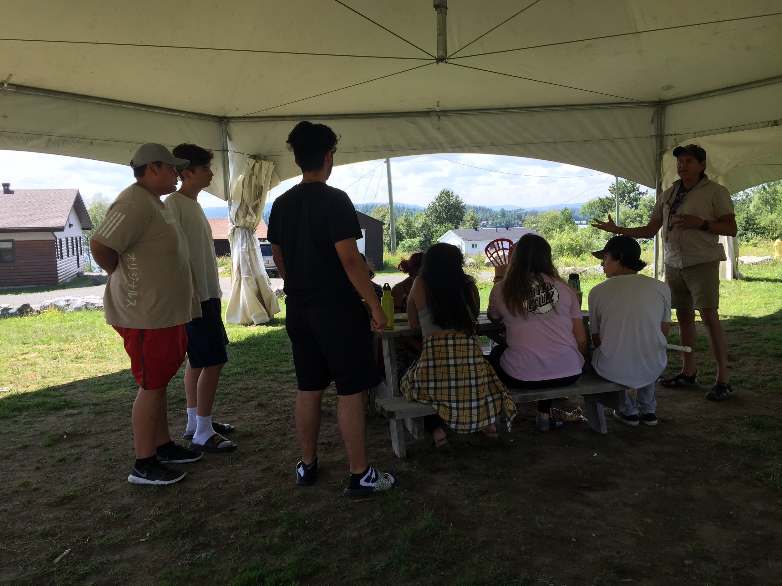 A meeting outside with Ray to discuss the canoe trip that happens after the film workshop!