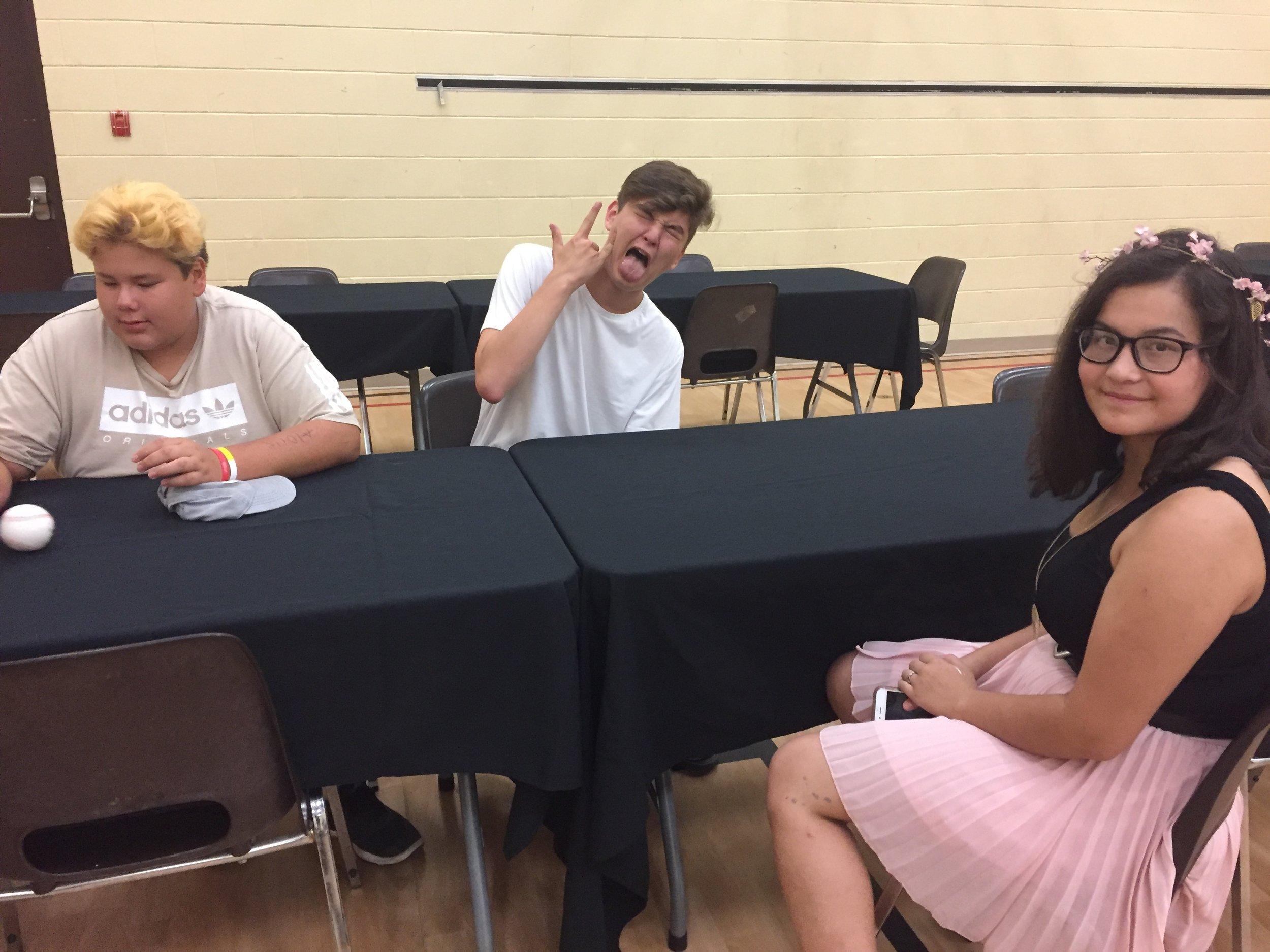 Cylus, Gabe and Kaiya preparing for screening