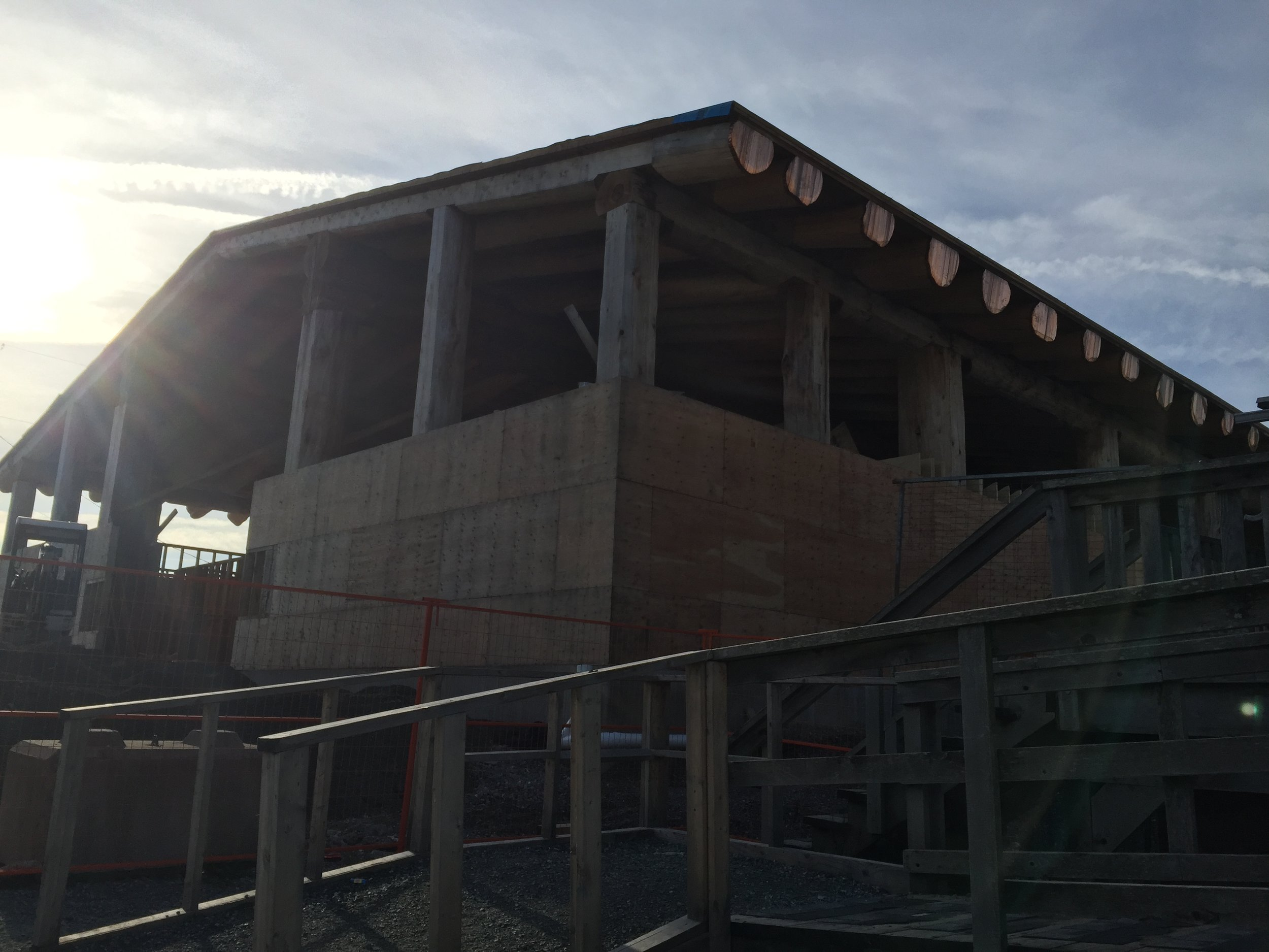 Notice the copper ends of the roof logs on the new BIG HOUSE being constructed!