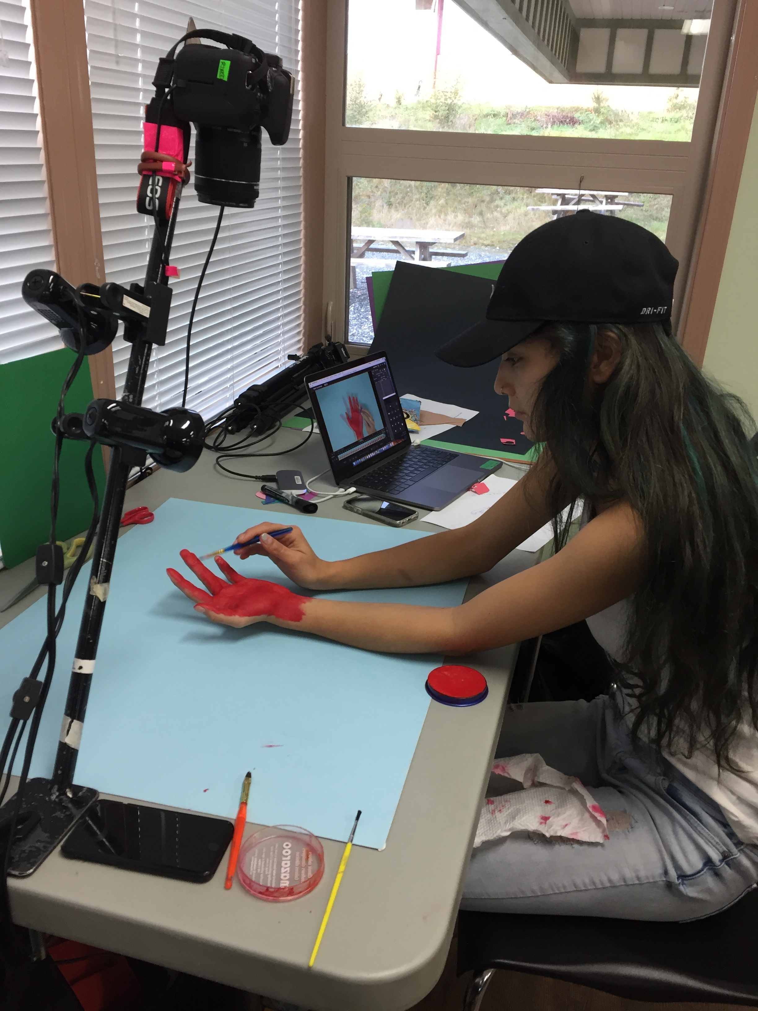 Bella paints her hand for the animation