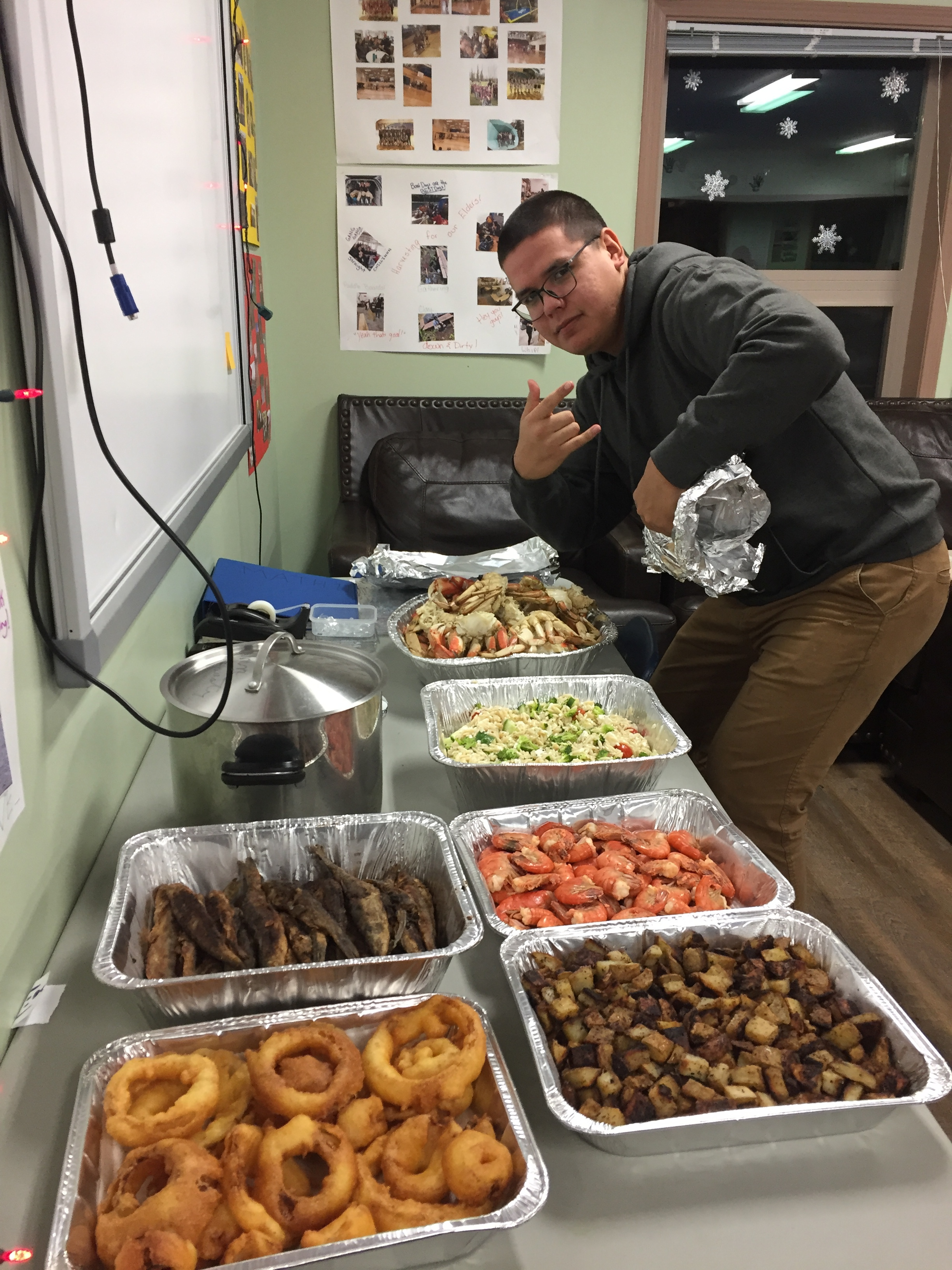Howie at the feast table 2: onion rings, eulachons, orzo salad, shrimp, potatoes, crab & seaweed soup!