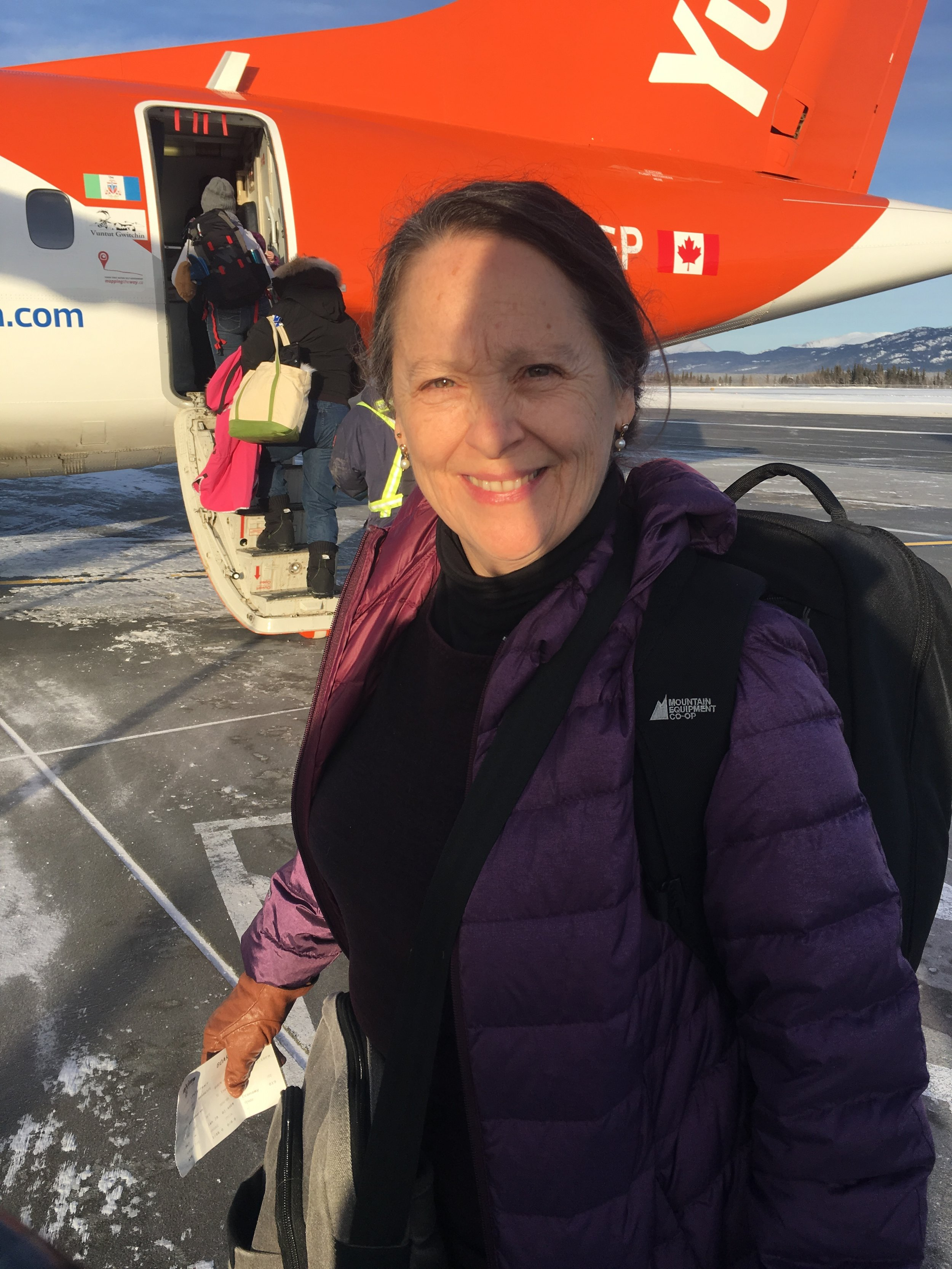 Tracy boarding the plane