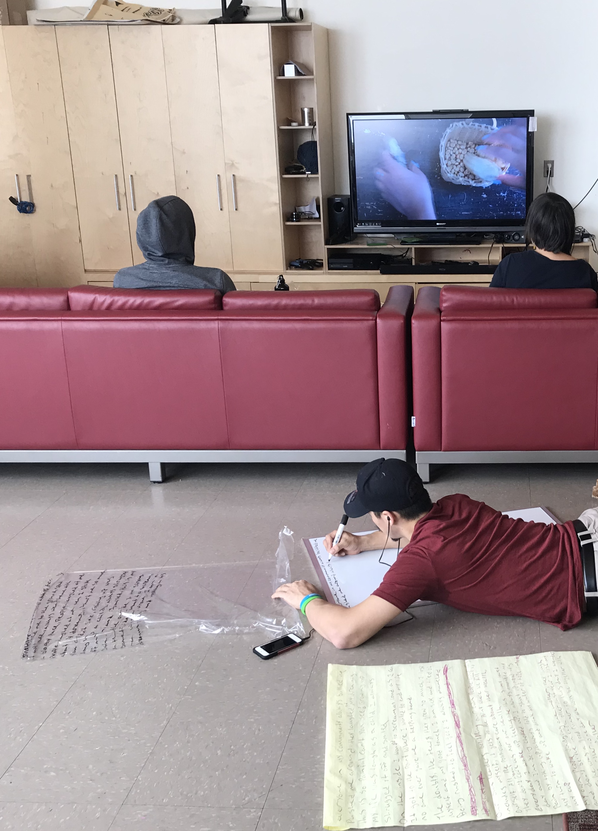 Adamie watches short films with Courtney while Nigel works on his story
