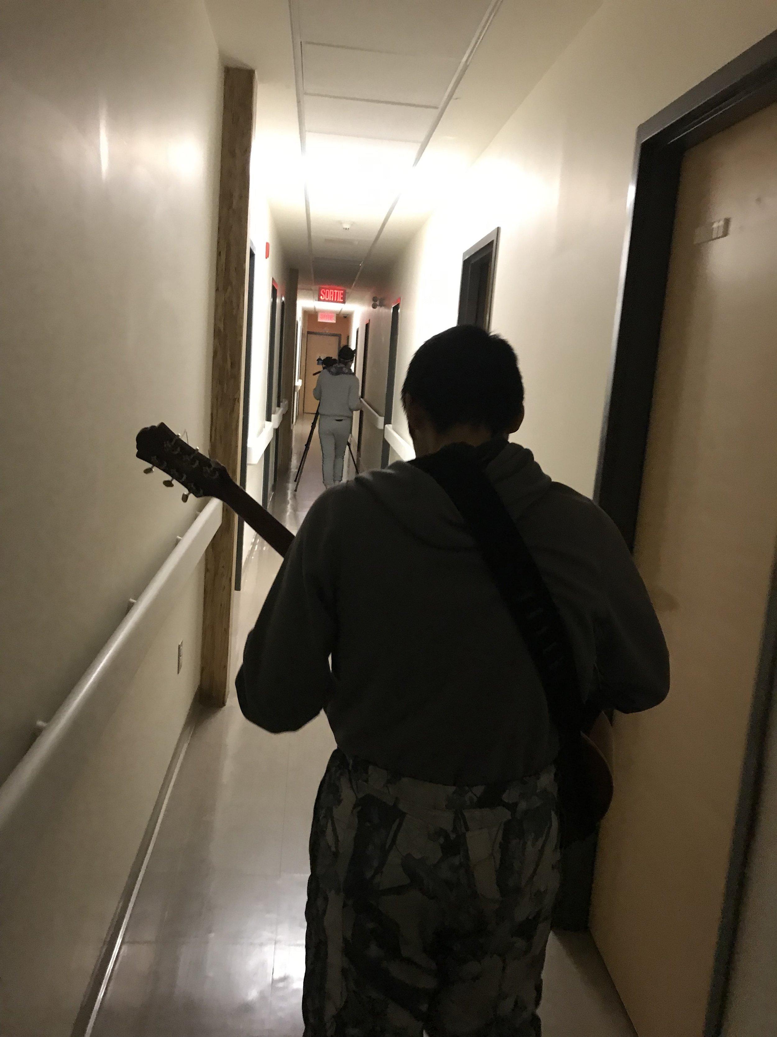 Adamie serenades our walk down the hallway