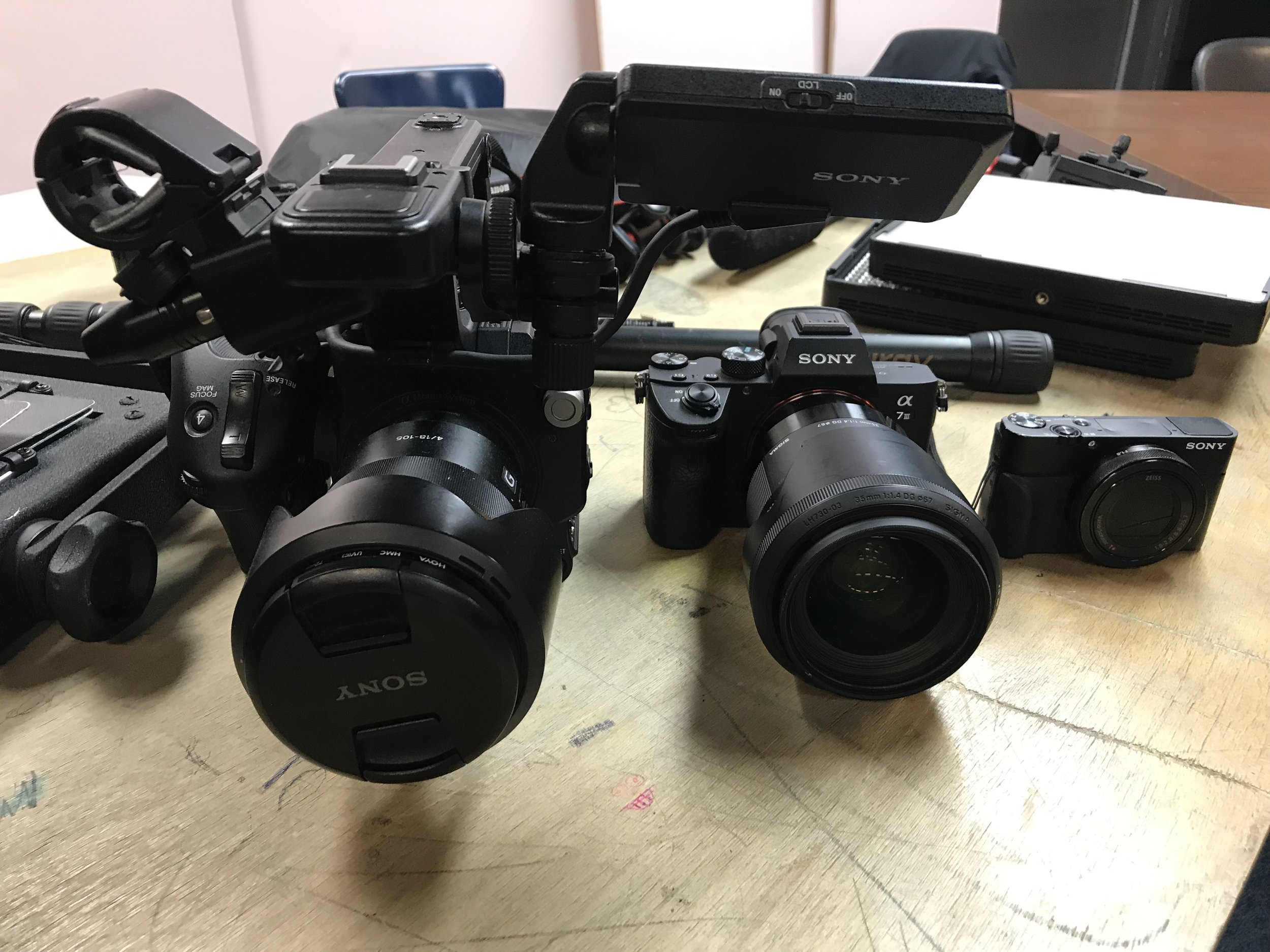 Patrick's three cameras that he uses for his own work
